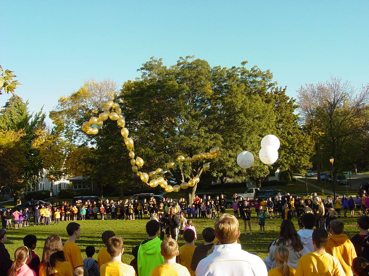 The Saint Joseph Catholic school family watches as the balloon rosary floats into the sky.