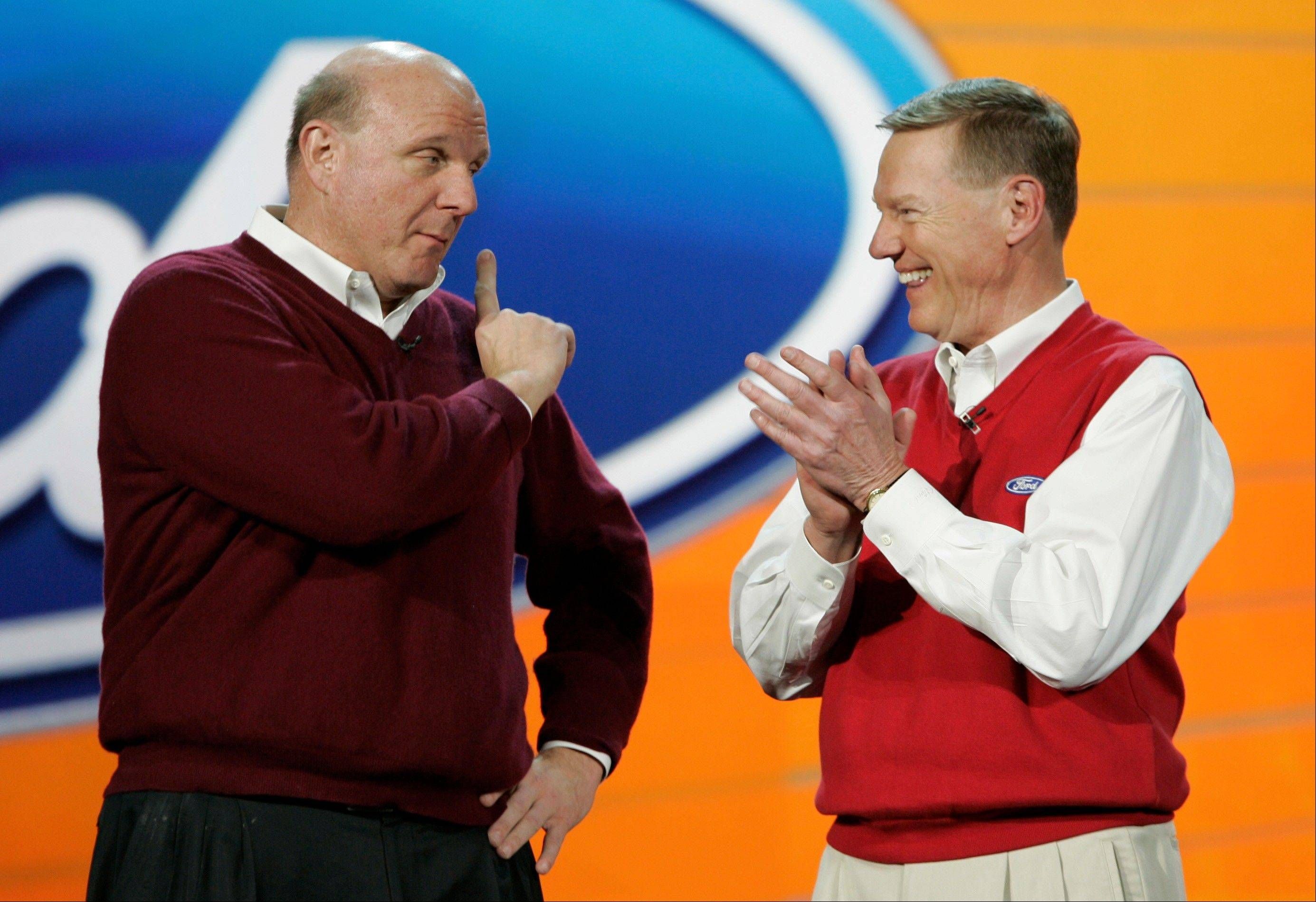 Ford Motor Company CEO and President Alan Mulally, right, listens to Microsoft CEO Steve Ballmer, left, during Mulally's keynote address at the International Consumer Electronics Show (CES) in Las Vegas. Mulally said Tuesday he's made no changes to his plan to stay at Ford through the end of 2014. But he hasn't denied rumors that Microsoft Corp. is courting him.