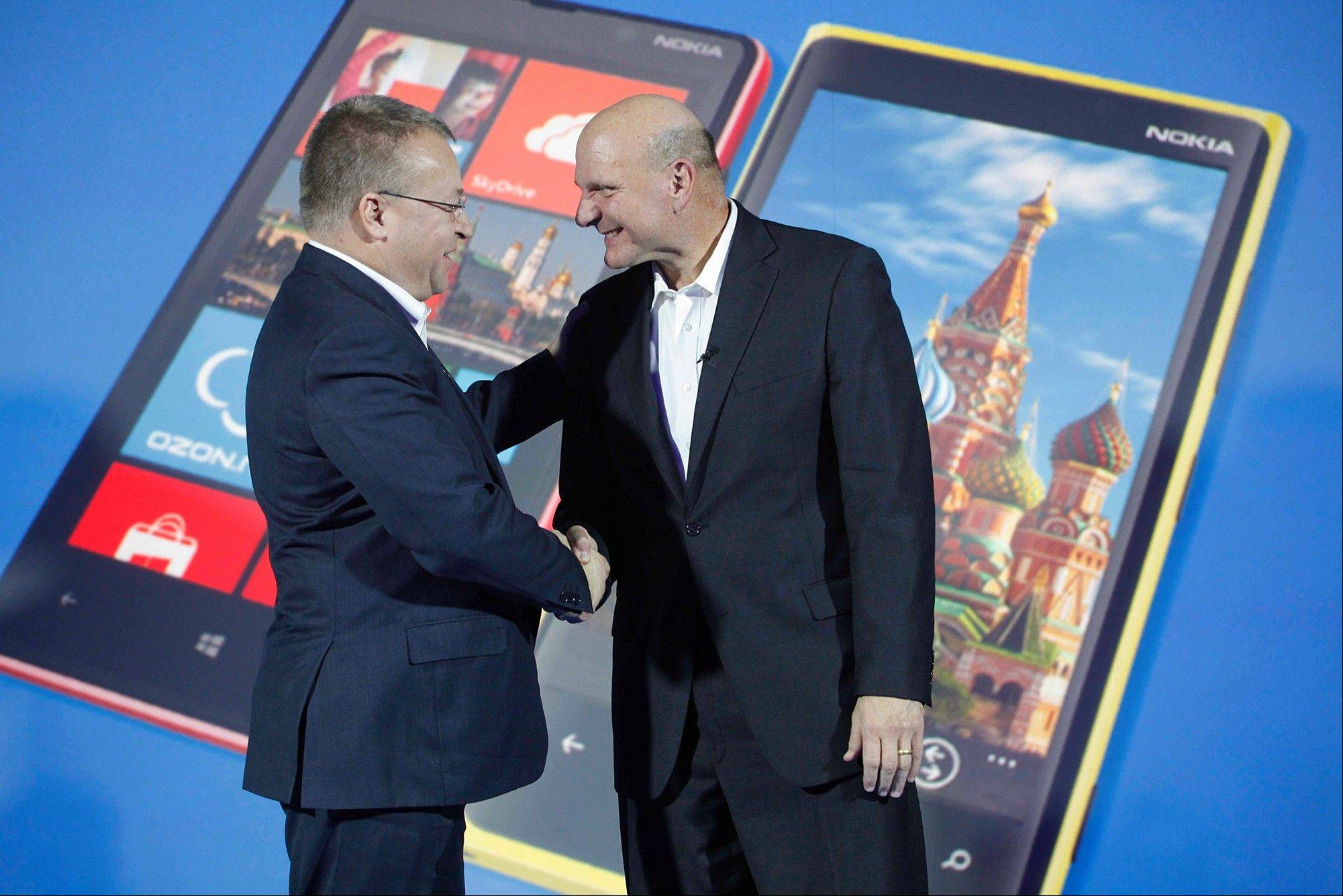 Nokia CEO Stephen Elop, left, and Microsoft CEO Steve Ballmer shake hands at a news conference in Moscow in November.