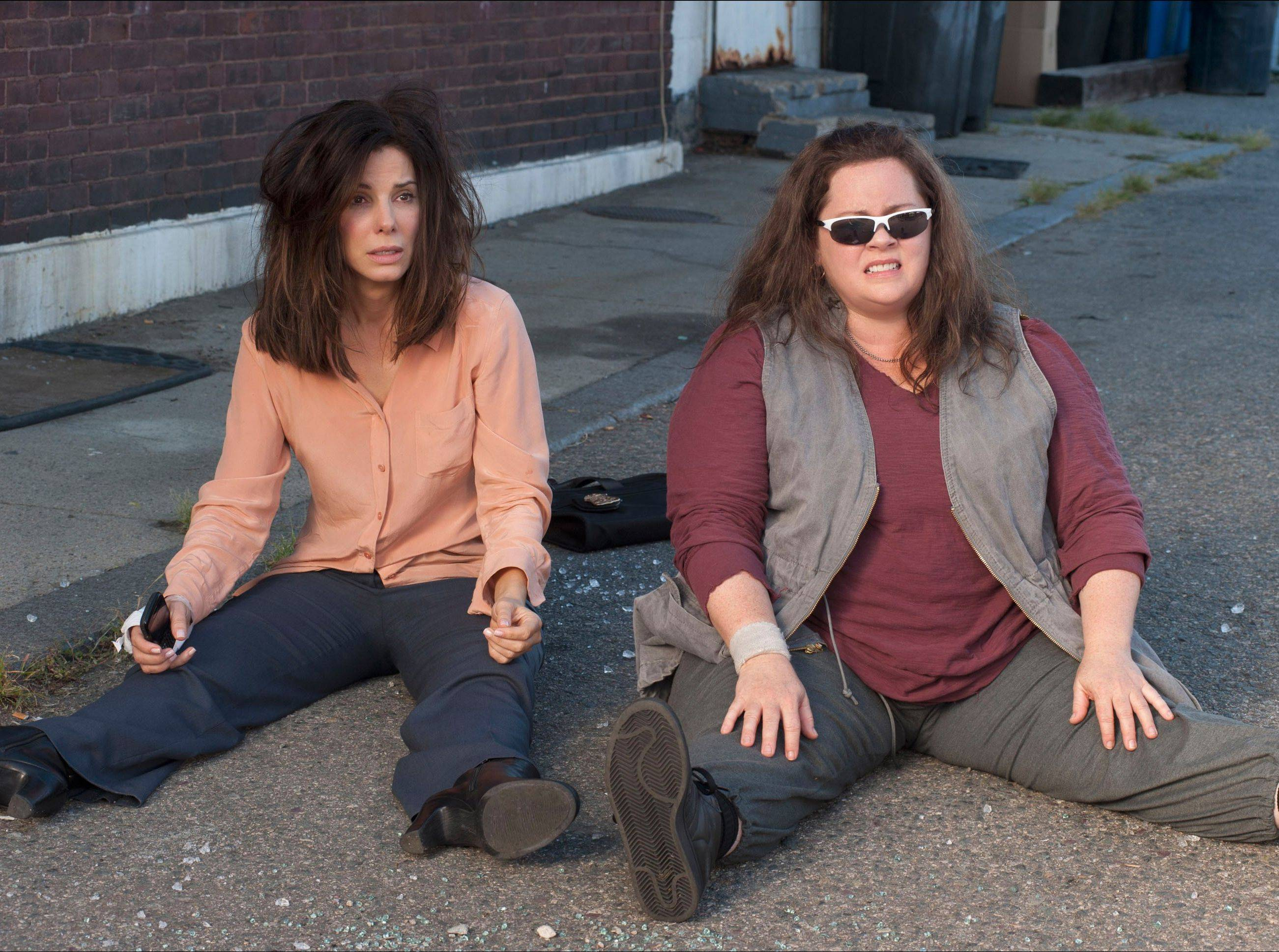 Sandra Bullock, left, and Plainfield native Melissa McCarthy star as mismatched partners trying to bring down a drug lord in �The Heat.�
