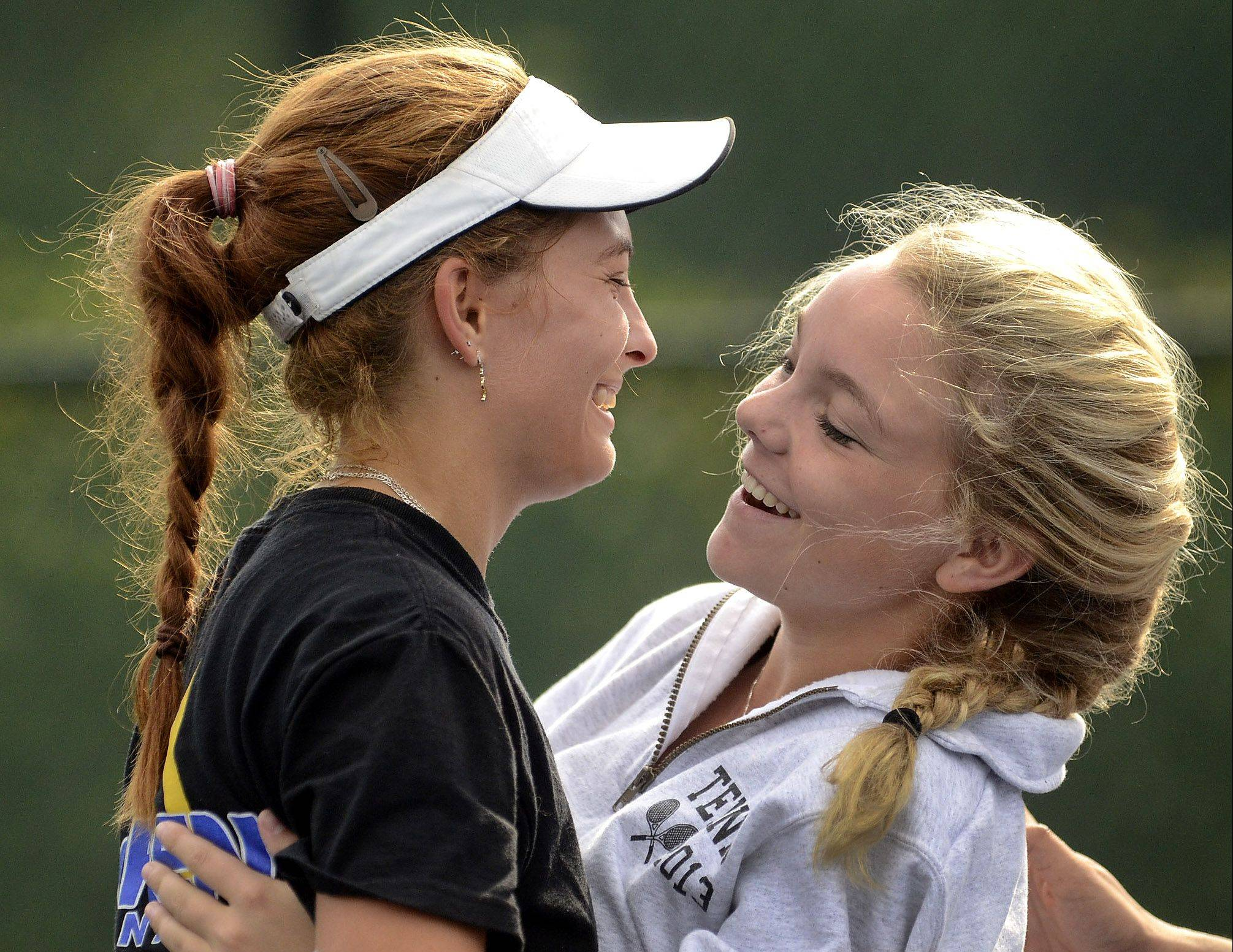 Karyna Bihel of Warren, left, is congratulated by Halle Roach of Libertyville after finishing second to Lake Forest's Elizabeth Zordani in the No. 1 singles match during the North Suburban Conference girls tennis finals at the Vernon Hills Athletic Complex on Saturday.