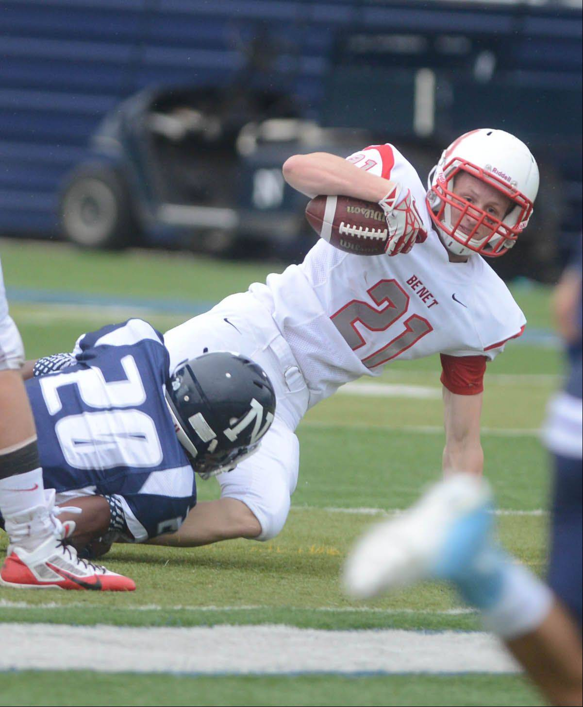 Ryan Parks of Benet is pulled down during the Redwings' loss to Nazareth Saturday.