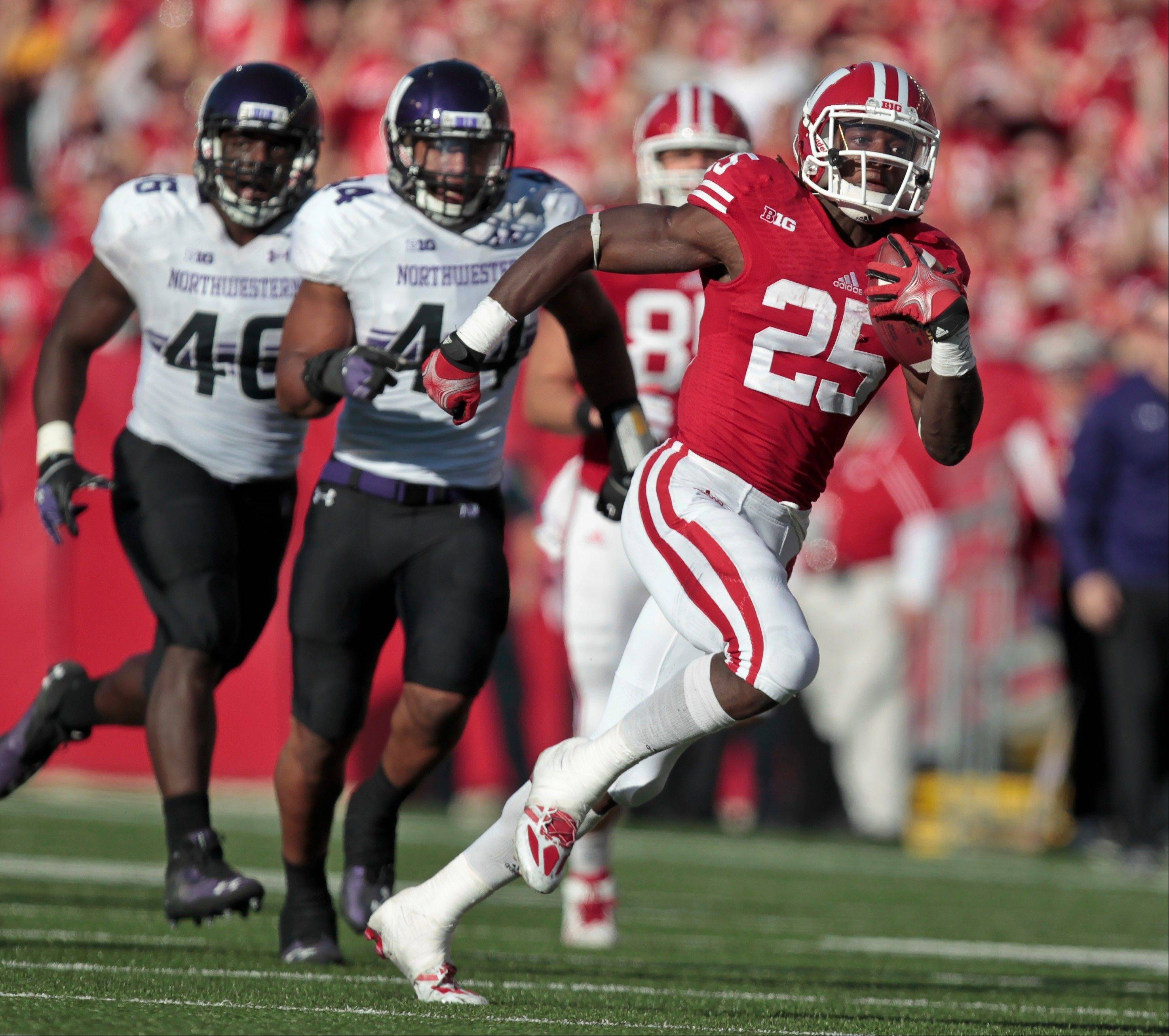 Wisconsin running back Melvin Gordon goes 71 yards for the touchdown Saturday as Northwestern�s Collin Ellis and Chi Chi Ariguzo watch.