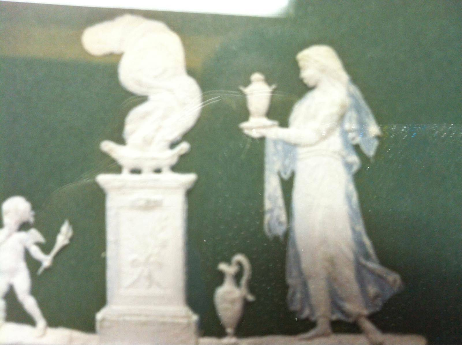 This green plaque with its unusual neoclassical decoration is Jasperware and may be Wedgwood.