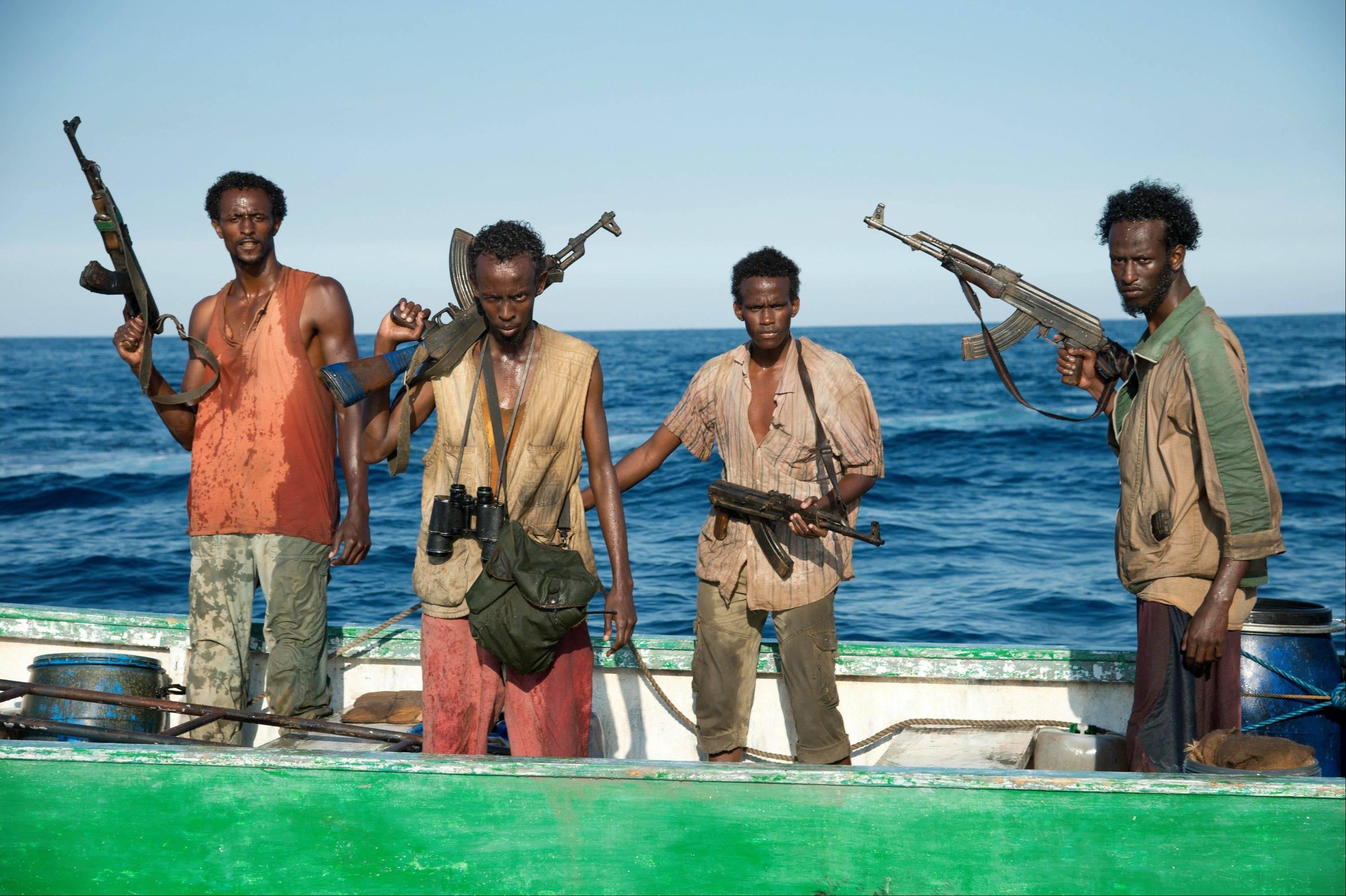 "Faysal Ahmed, left, Barkhad Abdi, Barkhad Abdirahman and Mahat Ali, all amateur actors of Somali descent from Minneapolis, made their film debut acting as Somali pirates alongside Tom Hanks in ""Captain Phillips."""