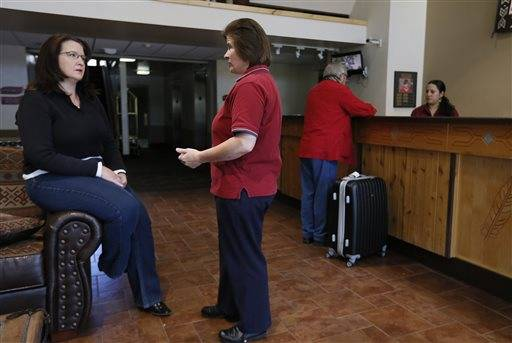 A concerned Julie Aldaz, left, general manager of the Red Feather Lodge, who has already had to layoff three employees, talks with Jane Gibson, housekeeping manager, about the dim prospects of Grand Canyon National Park reopening, as the park remains closed to visitors due to the continued federal government shutdown on Friday Oct. 11, 2013, in Tusayan, Ariz. Attempts by Arizona Gov. Jan Brewer to have the U.S. Department of the Interior open up portions of the park using state funds has hit a snag.