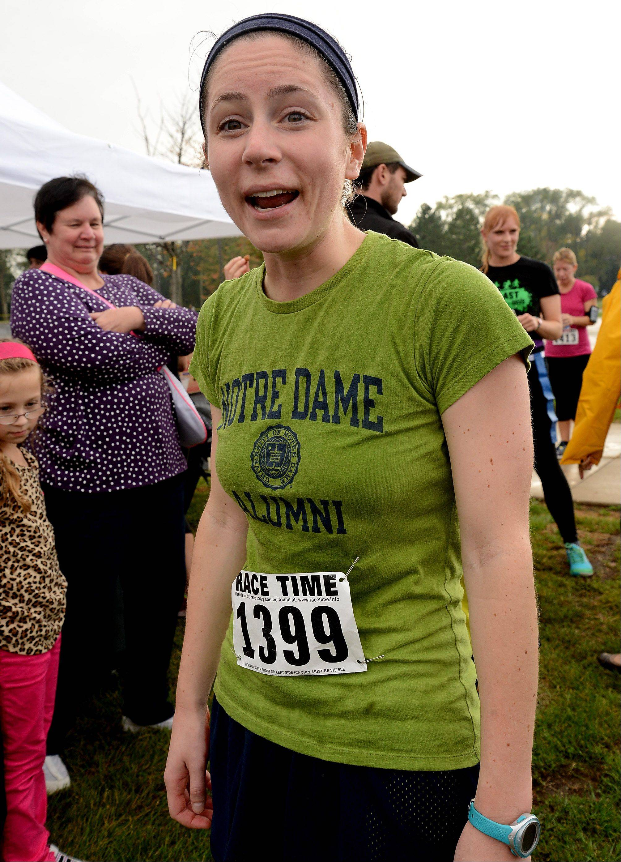 Katie Parnell of Morton Grove finished first overall Saturday but finished dead, losing both of her flags that the zombies tore off her during Grayslake's inaugural zombie run.