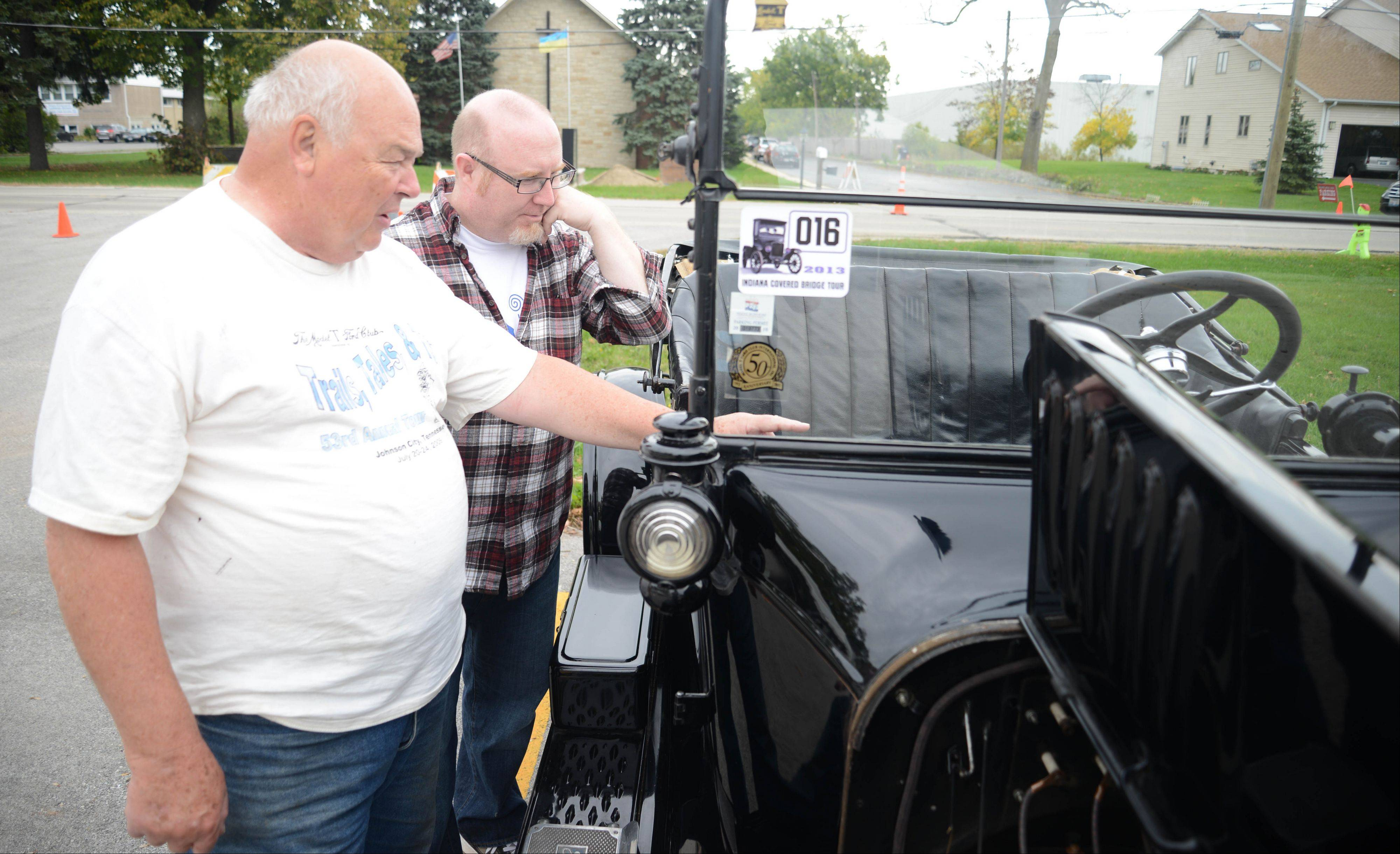 Tom Greifhahn of Bensenville, left, shows Lance Tawzer of Geneva his 1922 Model T at Bensenville's Heritage Day Saturday.