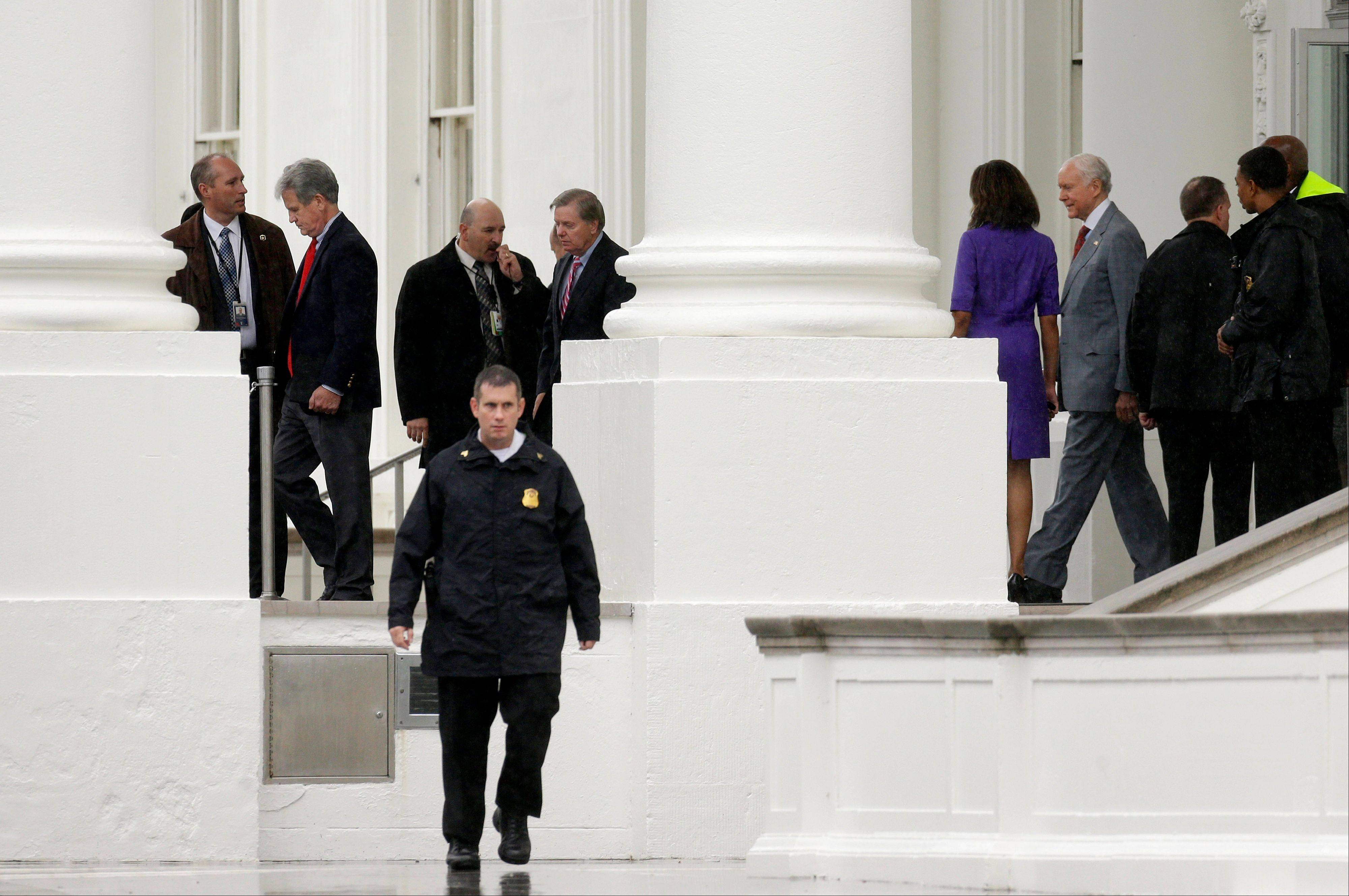 Associated PressRepublican senators, from left, Tom Coburn of Oklahoma, Lindsey Graham of South Carolina, center, and Orrin Hatch of Utah, leave Friday from the North Portico of the White House in Washington, after meeting with President Barack Obama regarding the government shutdown and debt ceiling.
