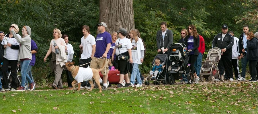 Participants walk in Naperville's ninth annual A Walk to Remember, which benefits the Edward Foundation SHARE program.