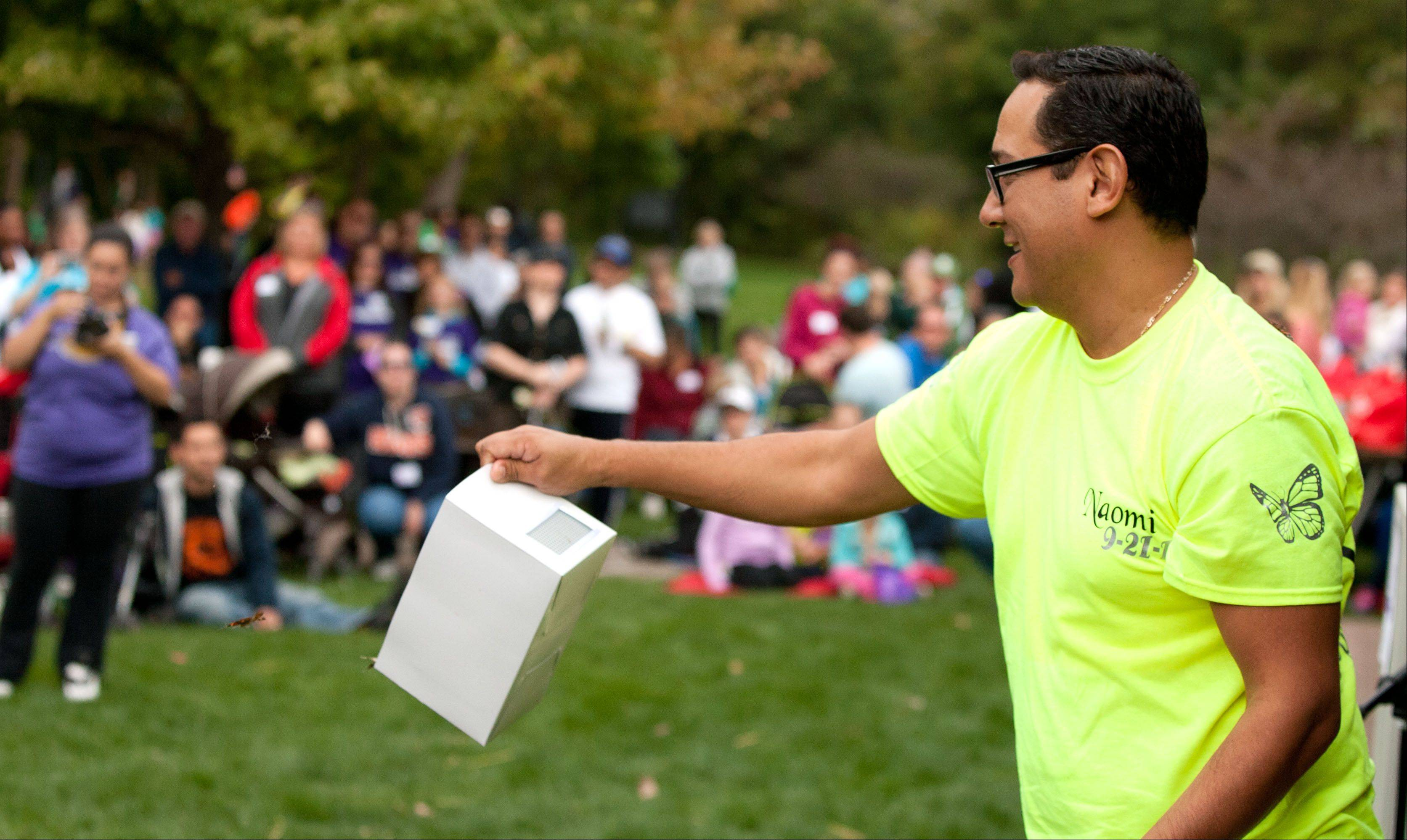 Jeff Garcia of Chicago releases butterflies during Naperville's ninth annual A Walk to Remember held at the Riverwalk Grand Pavilion. The walk benefits the Edward Foundation SHARE program.