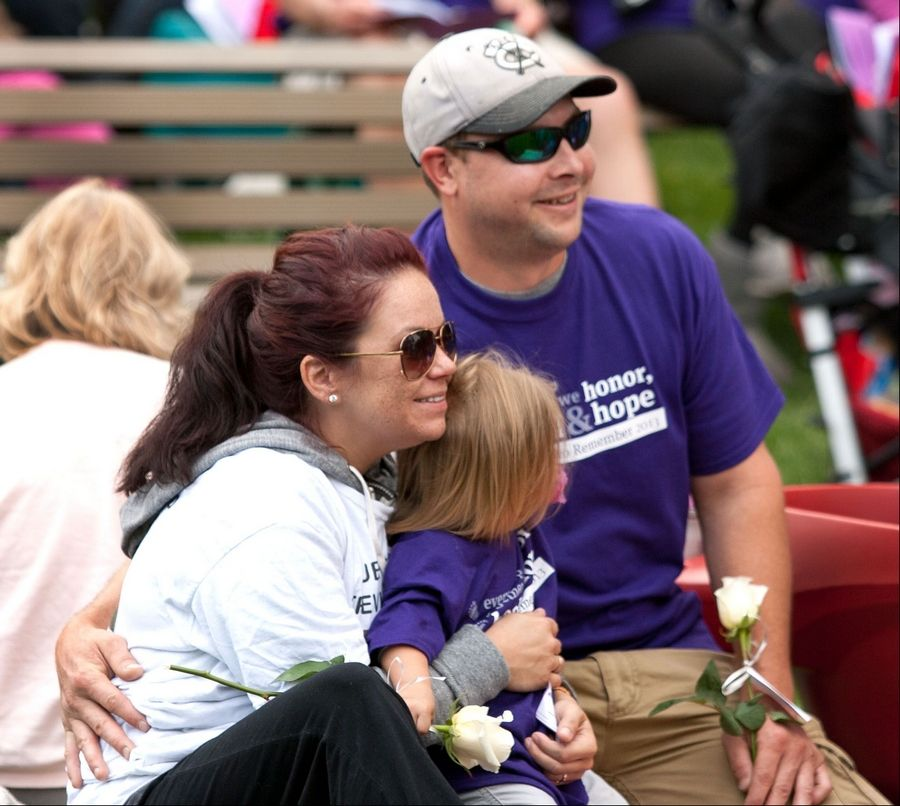 Nicole Trevino, her daughter Charlette Trevino of Medinah, and Jim Berousek participate in Naperville's ninth annual A Walk to Remember held at the Riverwalk Grand Pavilion. The walk benefits the Edward Foundation SHARE program.