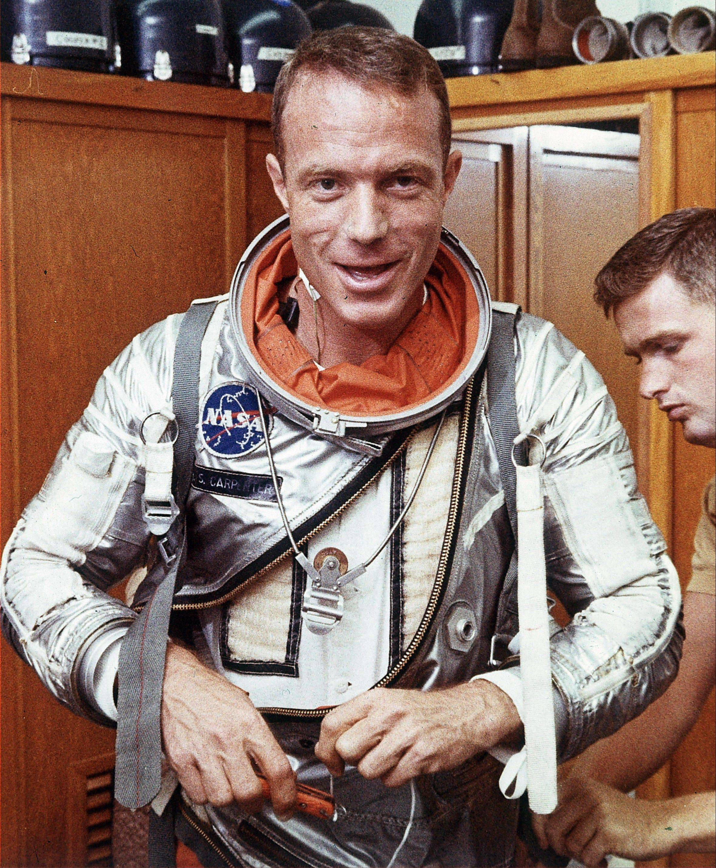 Astronaut Scott Carpenter has his space suit adjusted by a technician in Cape Canaveral, Fla.