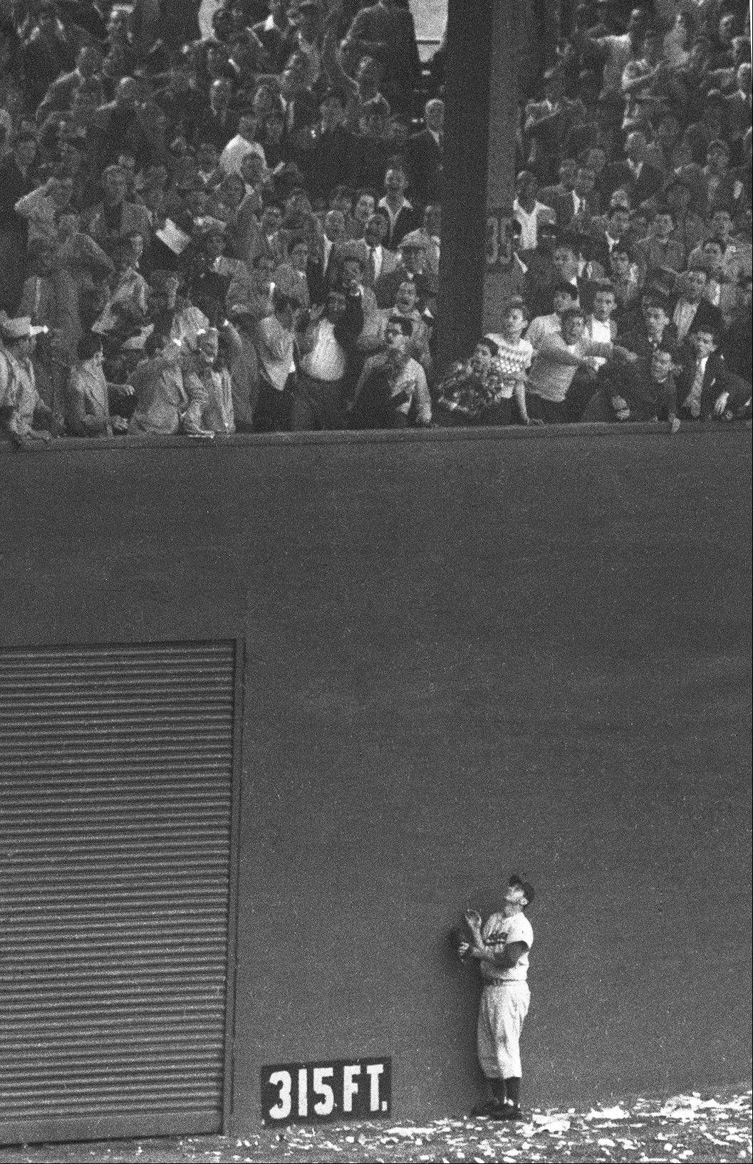 "Brooklyn Dodgers left fielder Andy Pafko watches as the ball sails over the wall and drops into the lower deck of seats for New York Giants' Bobby Thomson's three-run homer and so-called ""shot heard 'round the world,"" in the bottom of the ninth inning of the playoff game at the Polo Grounds in New York."