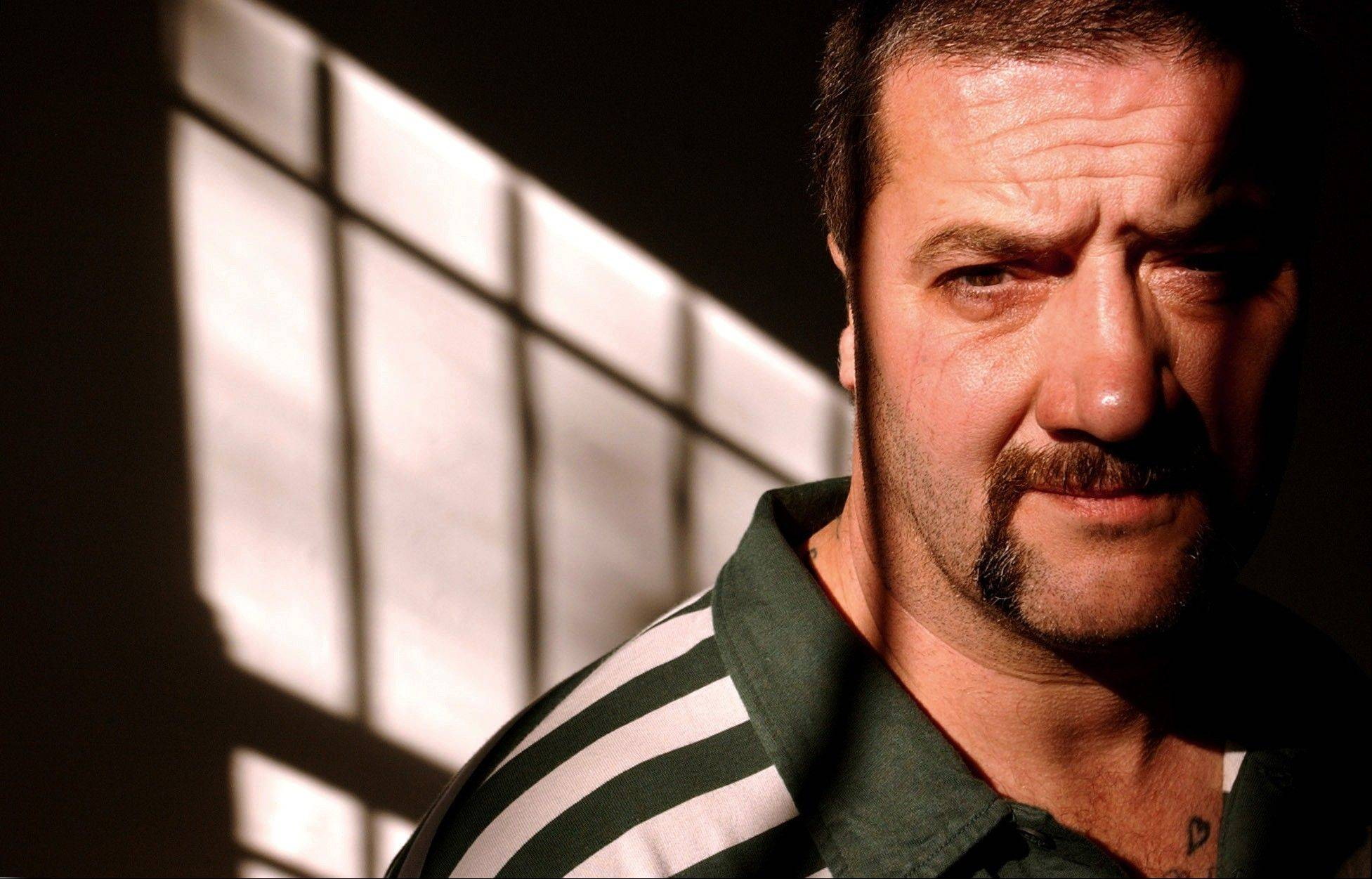 "Former underworld figure Mark ""Chopper"" Read poses for a photo during a launch of his book ""Hooky the Cripple"" in Sydney, Australia."