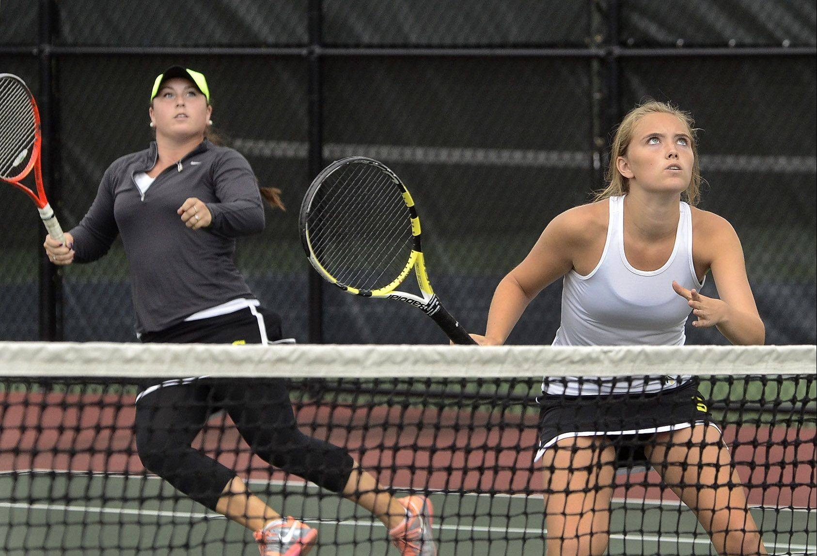 Bryn Rubin, left, and Caroline Kelmis of Stevenson, play for first place at third doubles during the North Suburban Conference girls tennis tournament finals at the Vernon Hills Athletic Complex.
