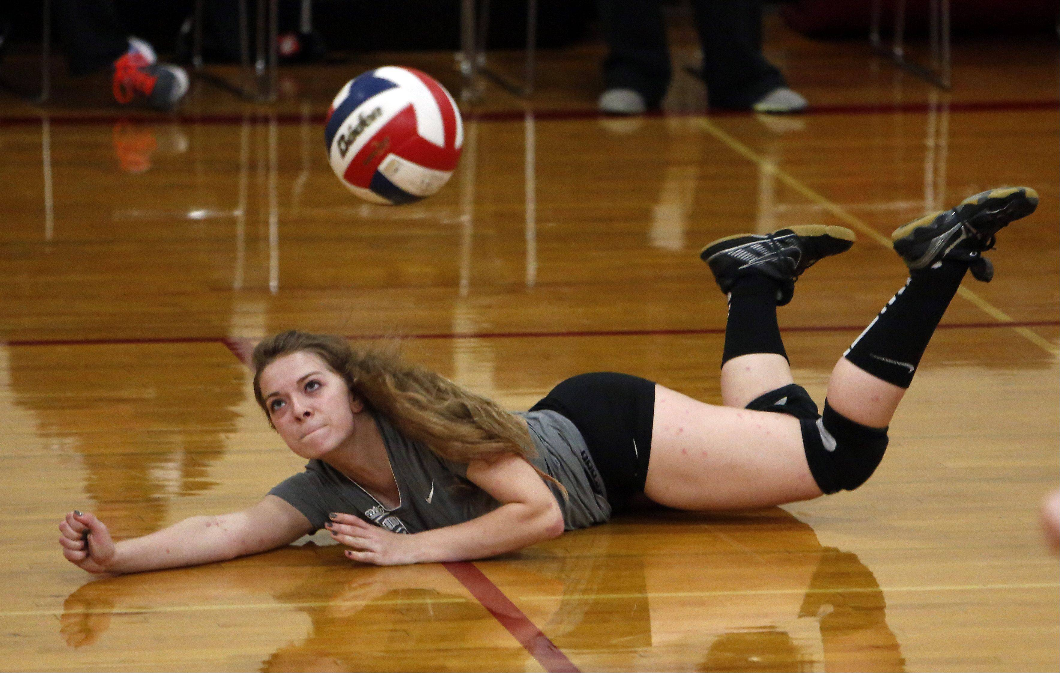 St. Edward's Clara McDowell goes to the floor for a Jacobs shot during the 29th Annual Huntley High School Volleyball Tournament Saturday.