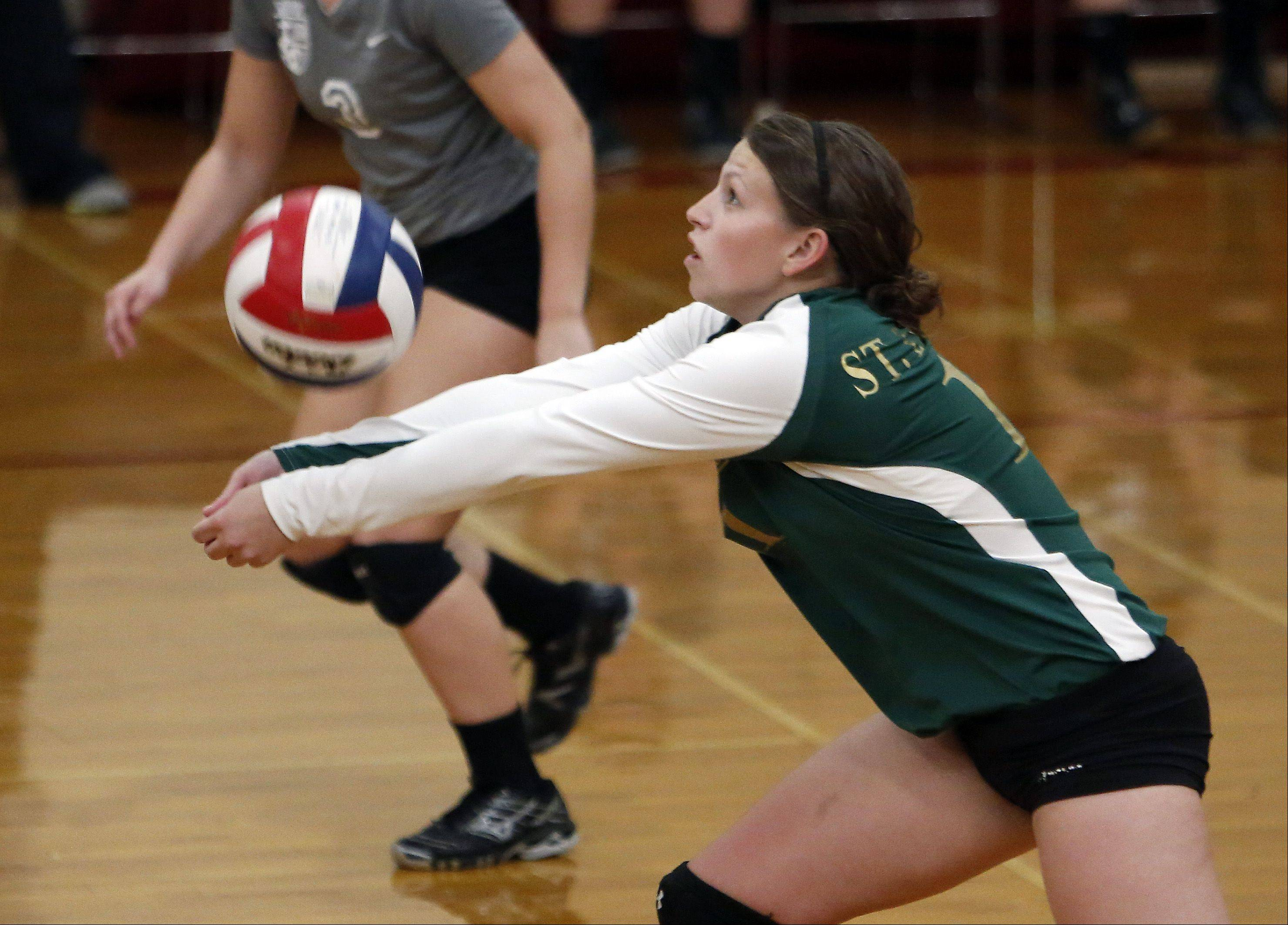 St. Edward's Katie Swanson returns a shot against Jacobs during the 29th Annual Huntley High School Volleyball Tournament Saturday.