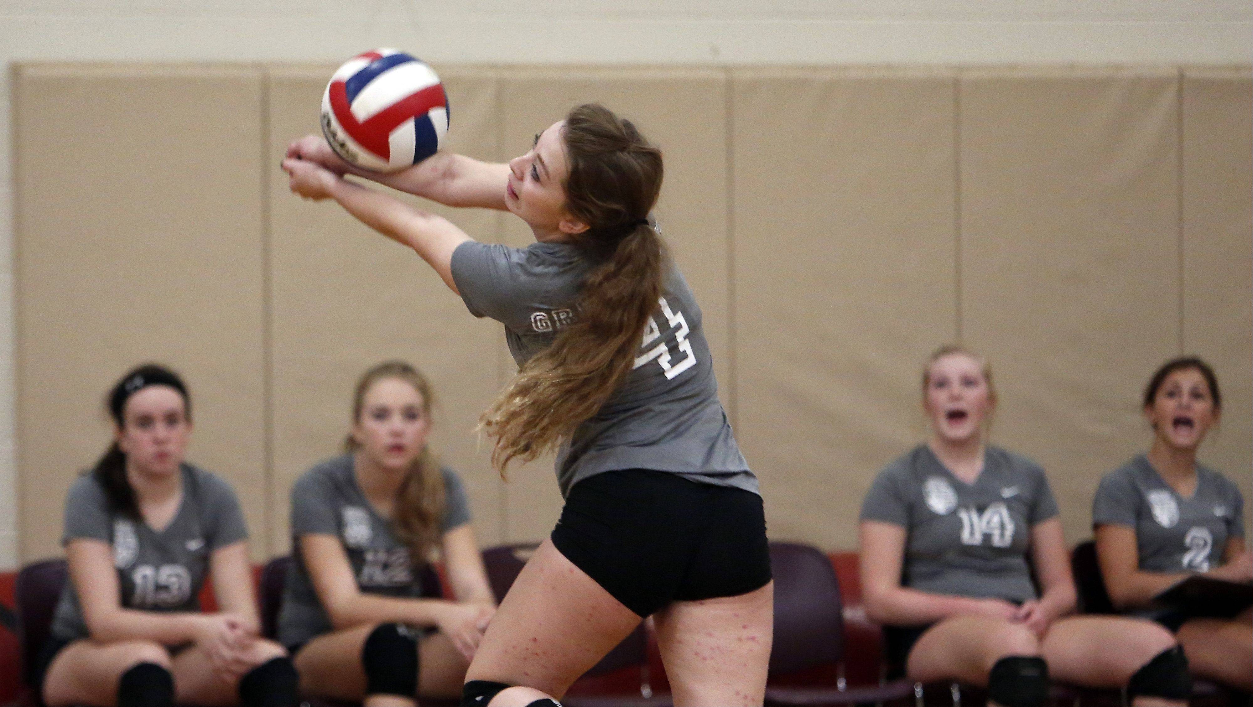 St. Edward's Clara McDowell with the dig against Jacobs during the 29th Annual Huntley High School Volleyball Tournament Saturday.