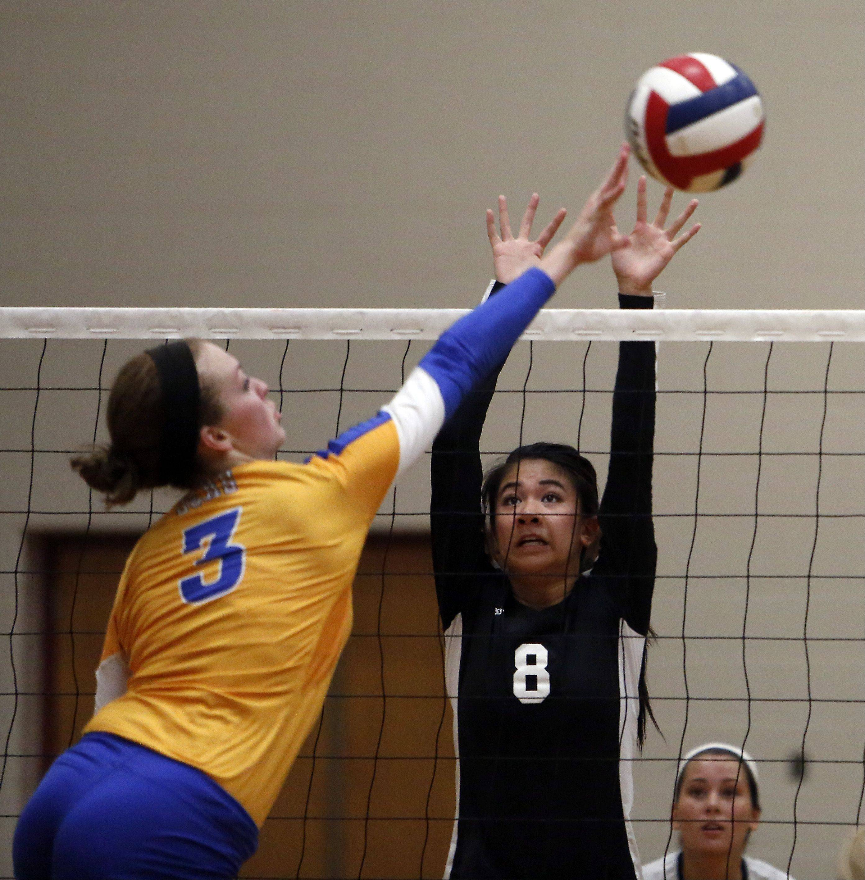 Joliet Central's Kelsey Frain tries to power a shot past a Glenbard North player during the 29th Annual Huntley High School Volleyball Tournament Saturday.