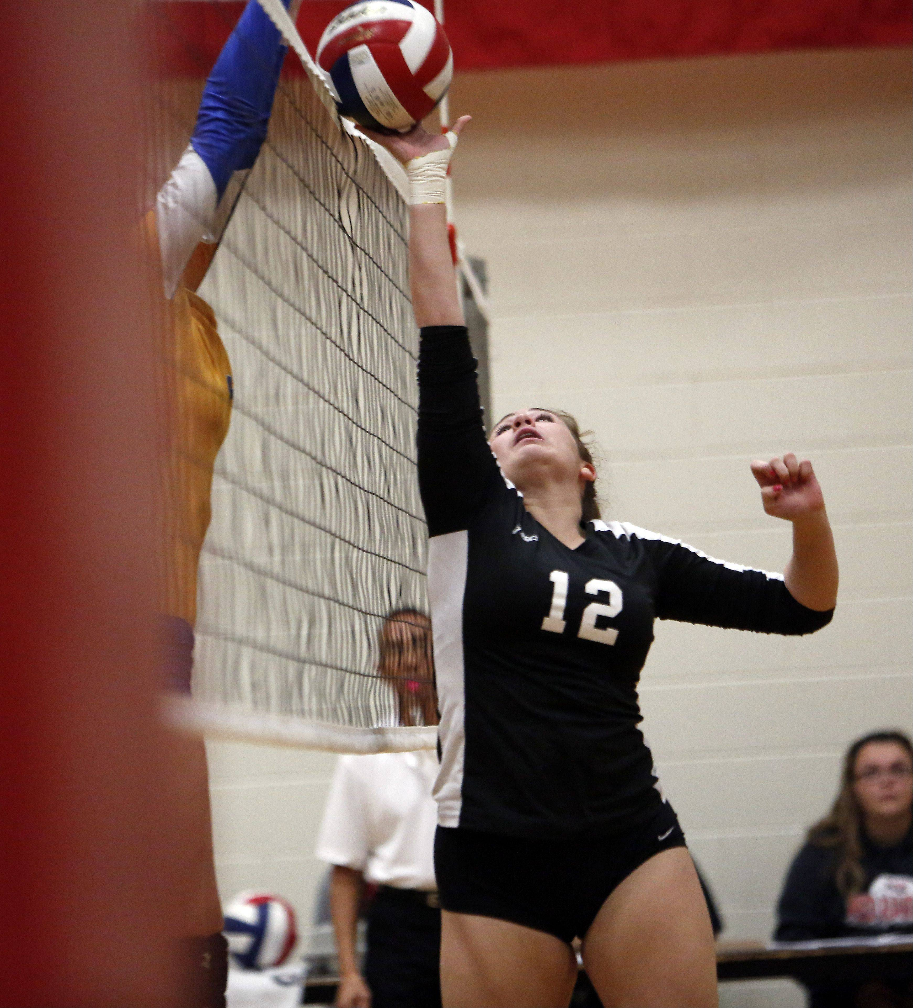 Glenbard North's Maria Perino tries to push one over against Joliet Central during the 29th Annual Huntley High School Volleyball Tournament Saturday.