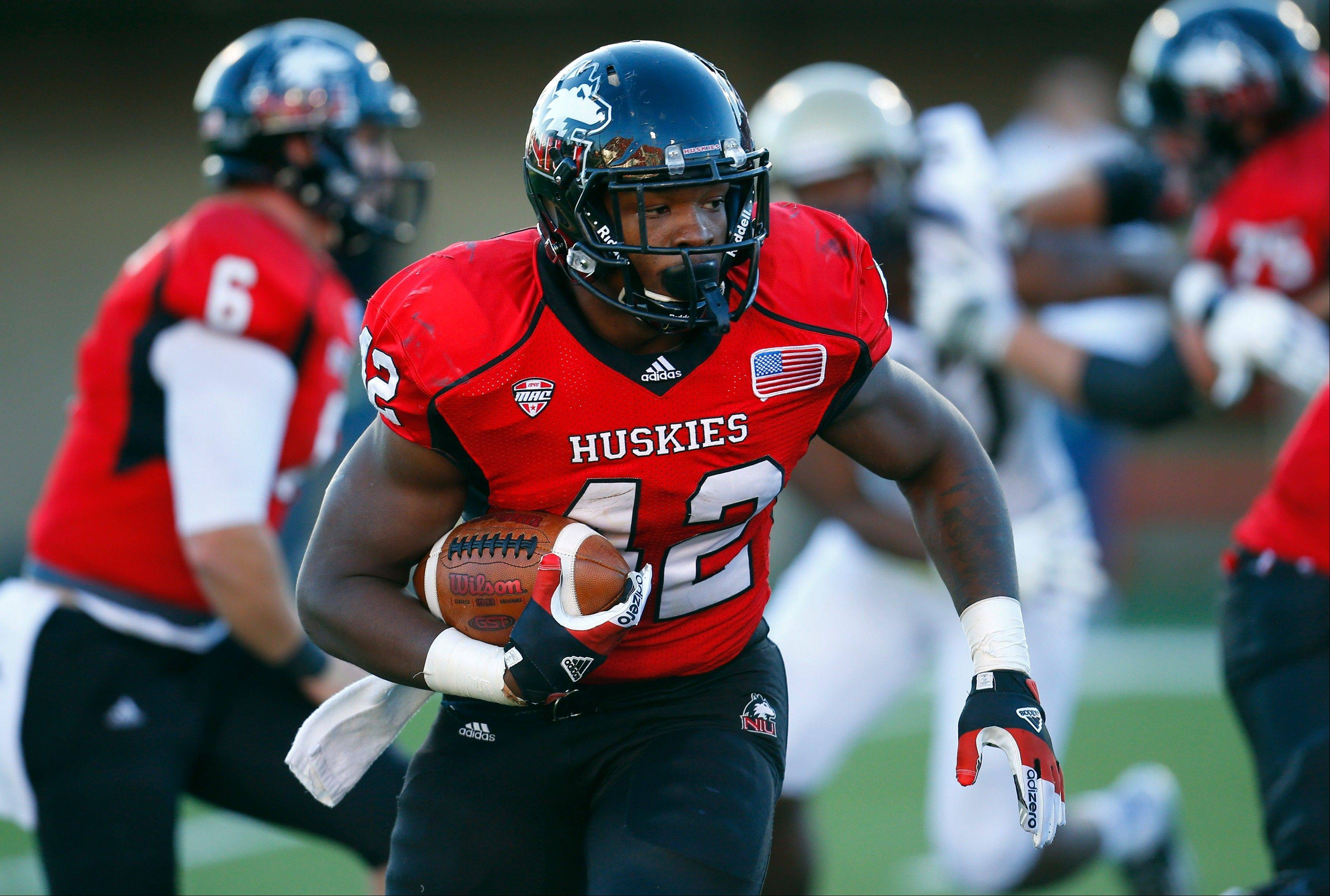 Northern Illinois running back Cameron Stingily runs the ball against Akron during Saturday's first half in DeKalb.