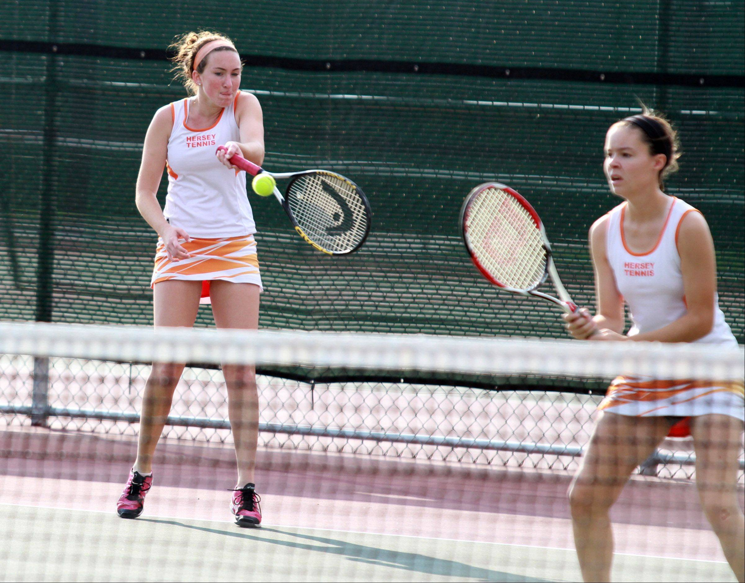 Hersey doubles players Megan Salt, left, and Emma Cooke compete against Buffalo Grove's Rachel Gross and Julia Zdunczyk in the Mid-Suburban League girls tennis meet Saturday at Rolling Meadows.