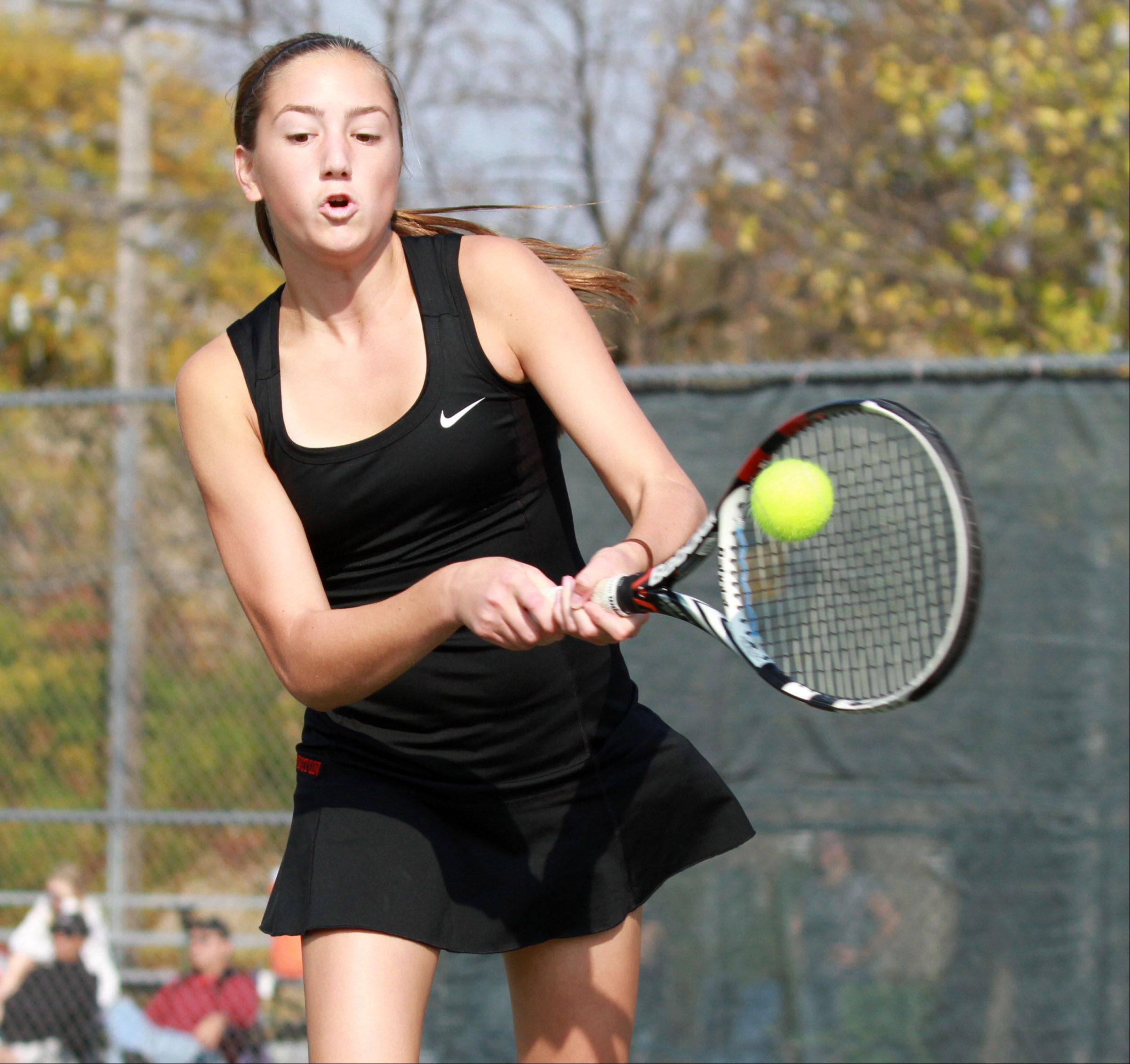 Anna Donoghue of Barrington swings at the ball while teamed up with Addie Hirsch in the No. 1 doubles championship match Saturday at Rolling Meadows.
