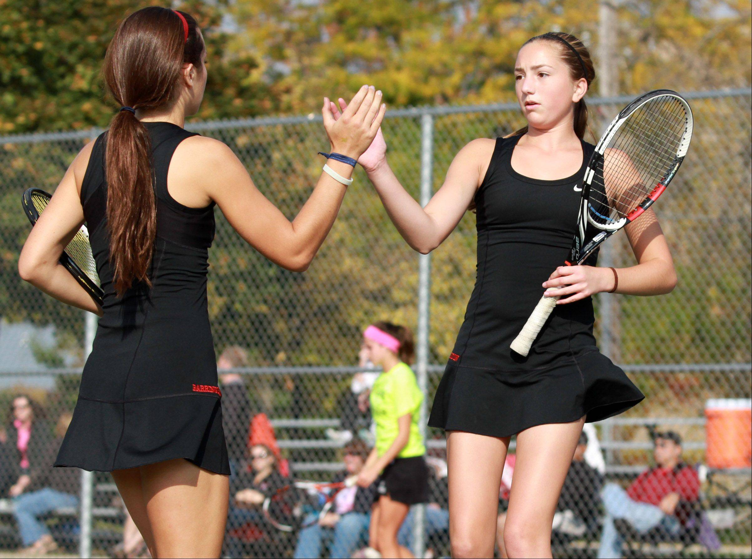 Barrington's Addie Hirsch high-fives doubles teammate Anna Donoghue in the No. 1 championship match Saturday at Rolling Meadows.