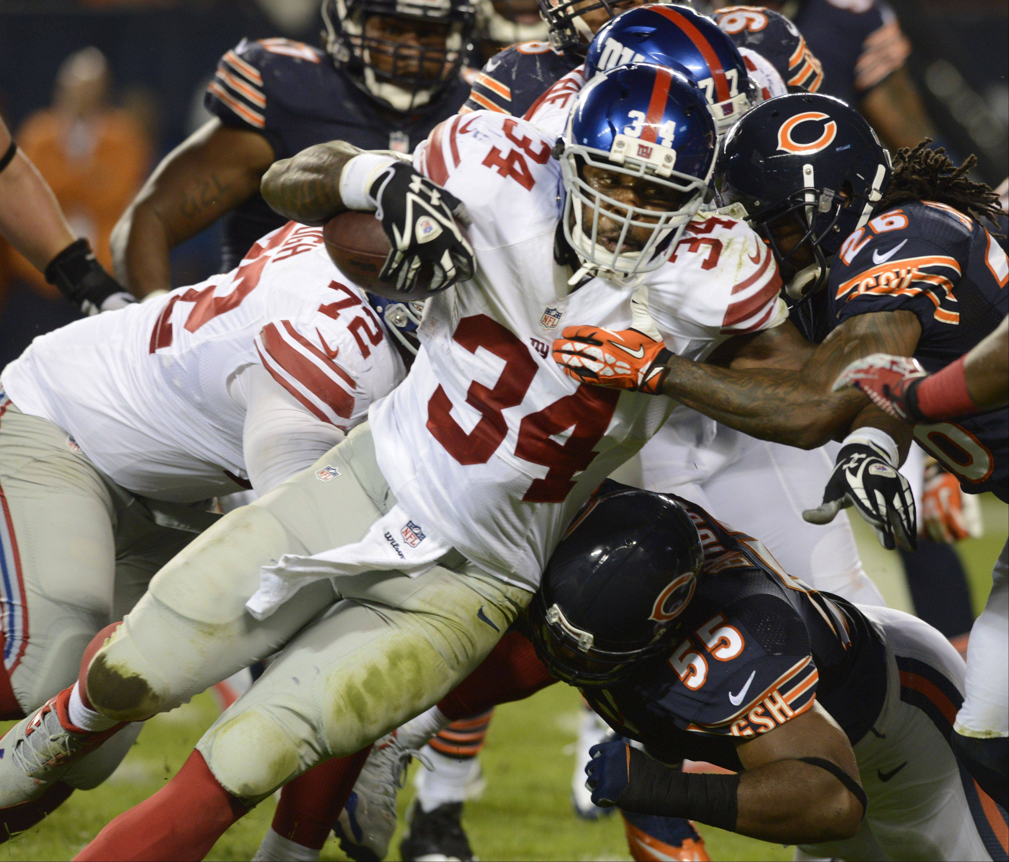 New York Giants running back Brandon Jacobs drags the Chicago Bears defense with him for a touchdown during Thursday's game at Soldier Field.