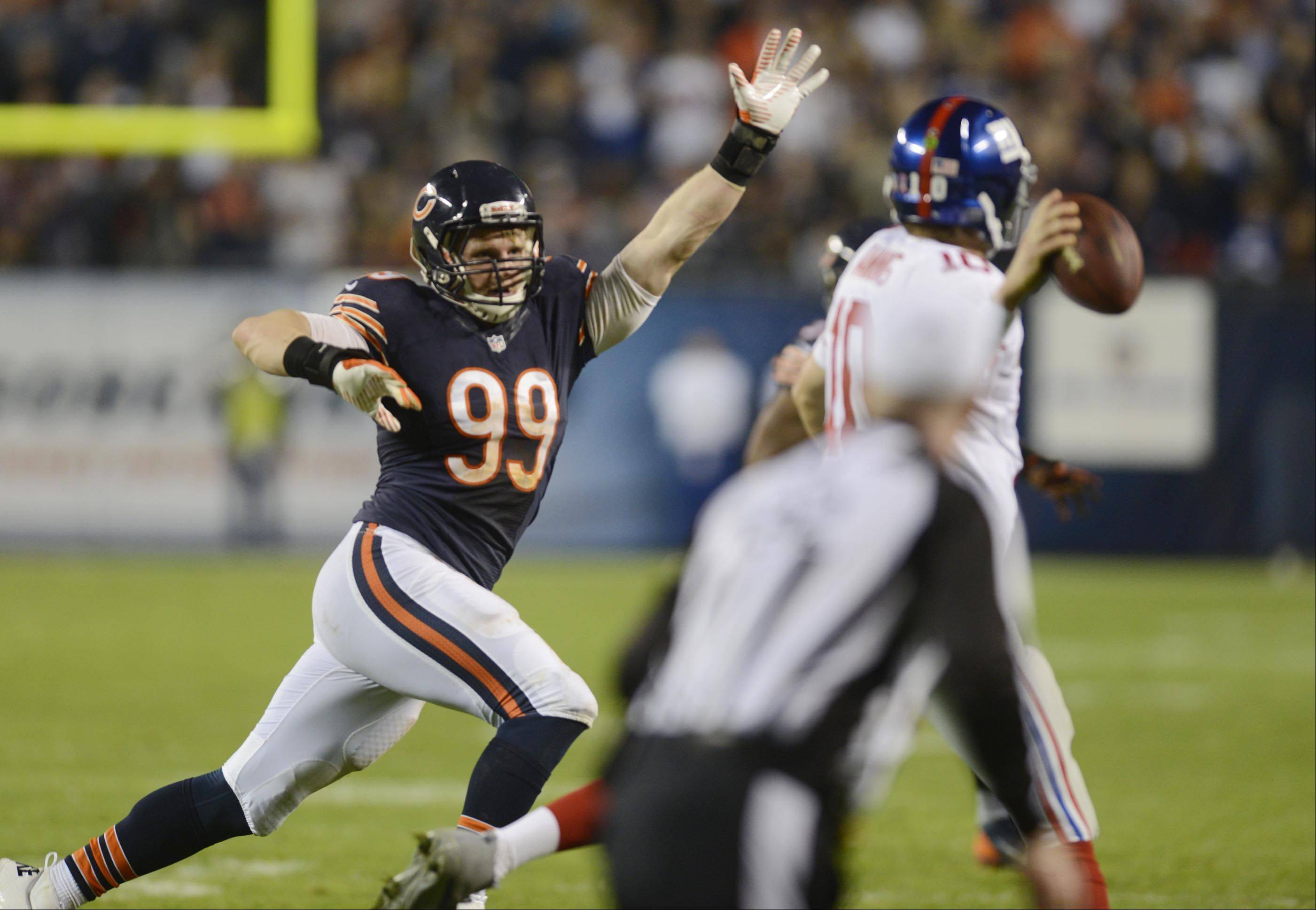 Bears defensive end Shea McClellin pressures New York Giants quarterback Eli Manning Thursday night at Soldier Field in Chicago.