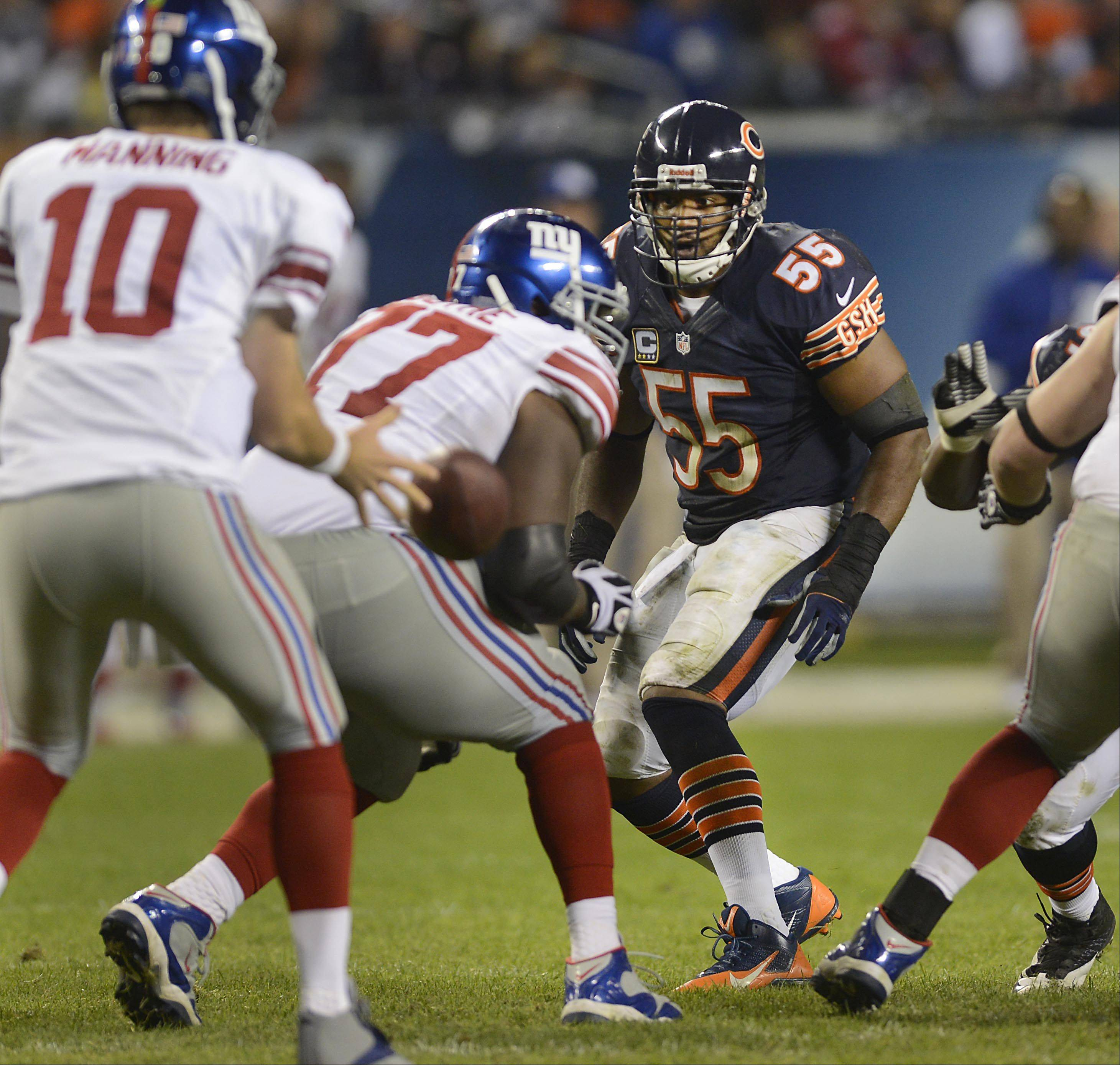 Bears outside linebacker Lance Briggs reacts as the ball is hiked to New York Giants quarterback Eli Manning Thursday night at Soldier Field in Chicago.