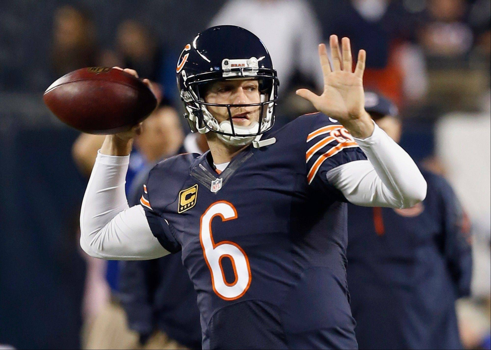 Jay Cutler throws during warm-ups for the Bears' NFL football game against the New York Giants, Thursday, Oct. 10, 2013, in Chicago.