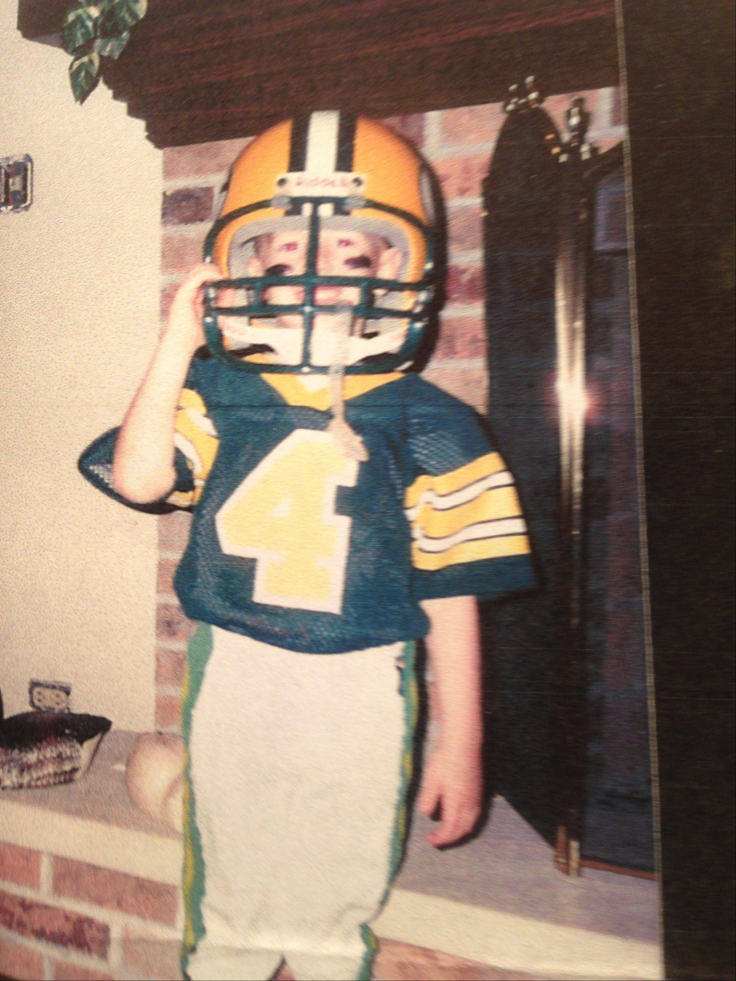 Photo courtesy of Scott TolzienTo celebrate his fifth birthday, Scott Tolzien was given a No. 4 Packers uniform by his dad. Today the former Wisconsin quarterback plays for the Packers as a member of their practice squad.