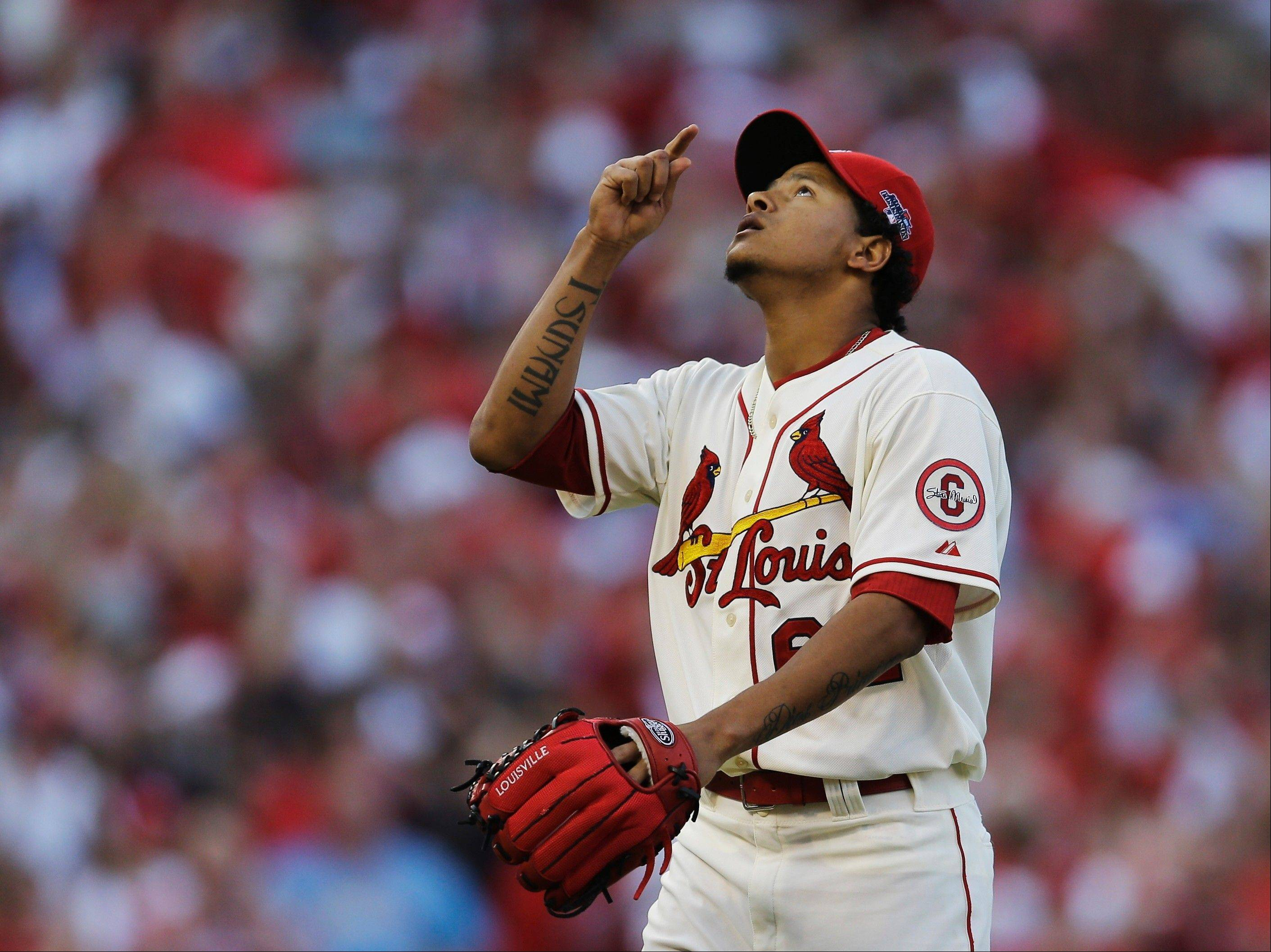 St. Louis Cardinals relief pitcher Carlos Martinez sky-points after striking out the Los Angeles Dodgers' Adrian Gonzalez in Saturday's eighth inning.