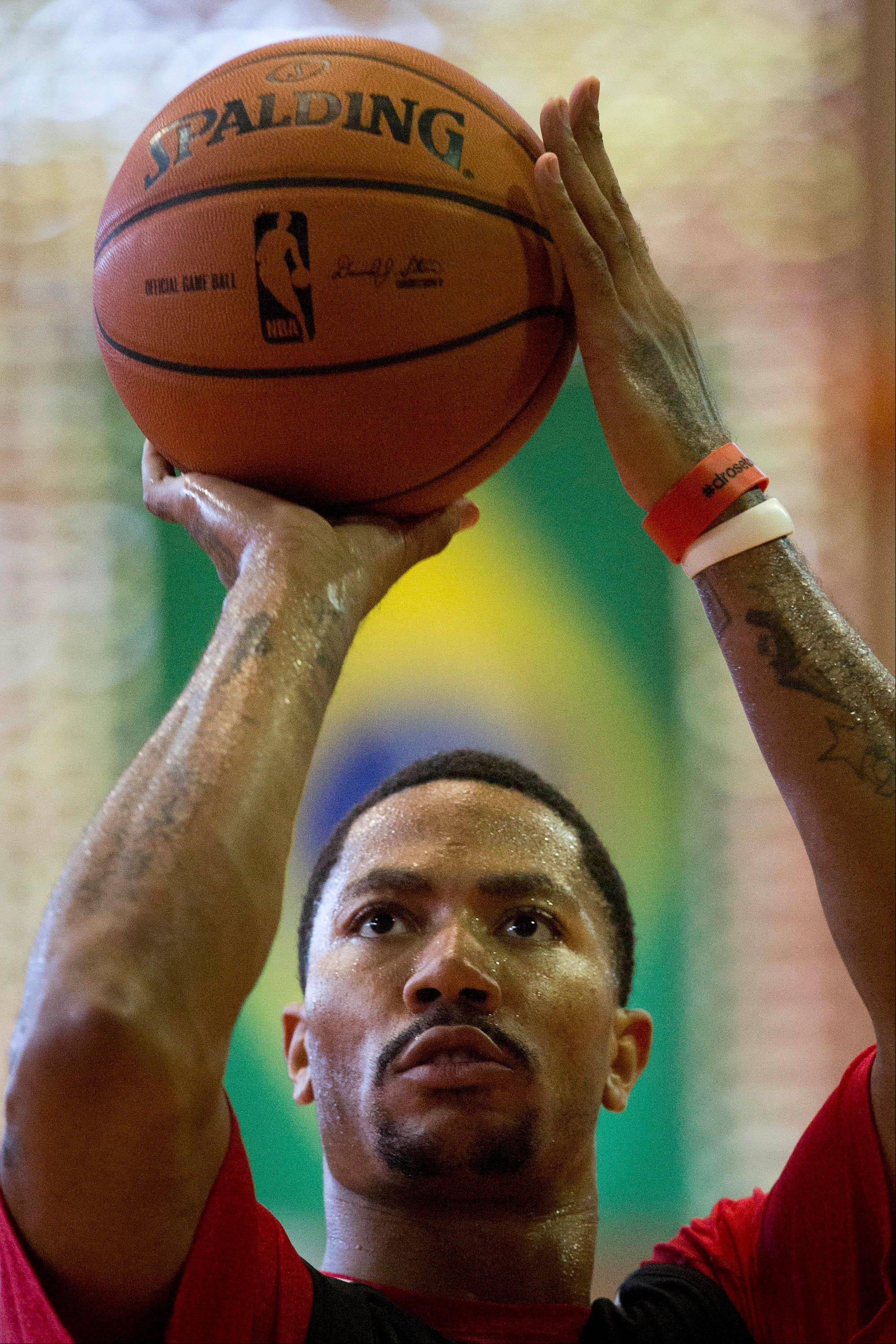 Chicago Bulls' Derrick Rose shoots during a practice session ahead of a NBA Global Games match against Washington Wizards in Rio de Janeiro, Brazil, Wednesday, Oct. 9, 2013. The Chicago Bulls will face Washington Wizards on Oct. 12 in the first-ever NBA game in Brazil.
