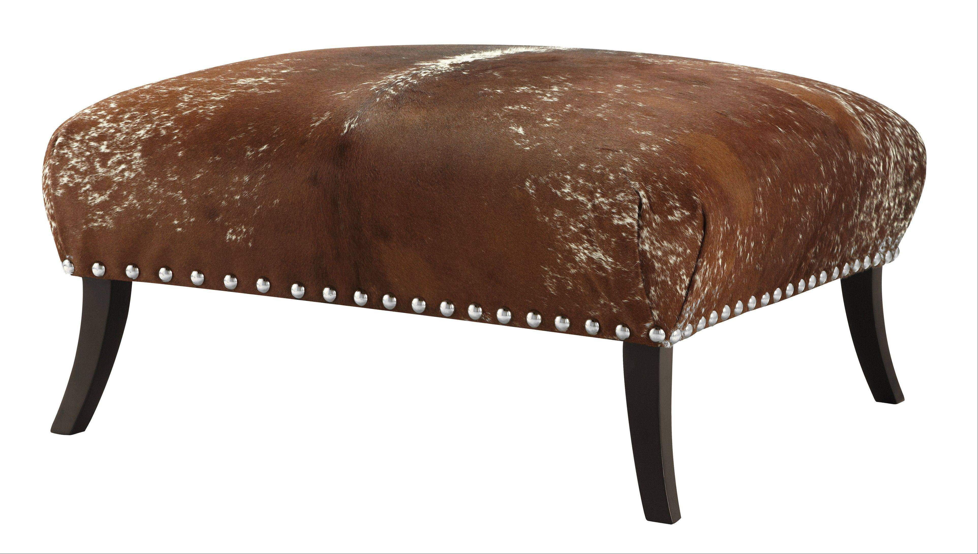 Both nail heads and rivets are having a moment in contemporary decor. On some pieces, they reinforce traditional elegance; and on others, they offer an urban, edgier aesthetic. The Alpine Estates hair-on-hide ottoman puts a modern spin on Old West furniture.