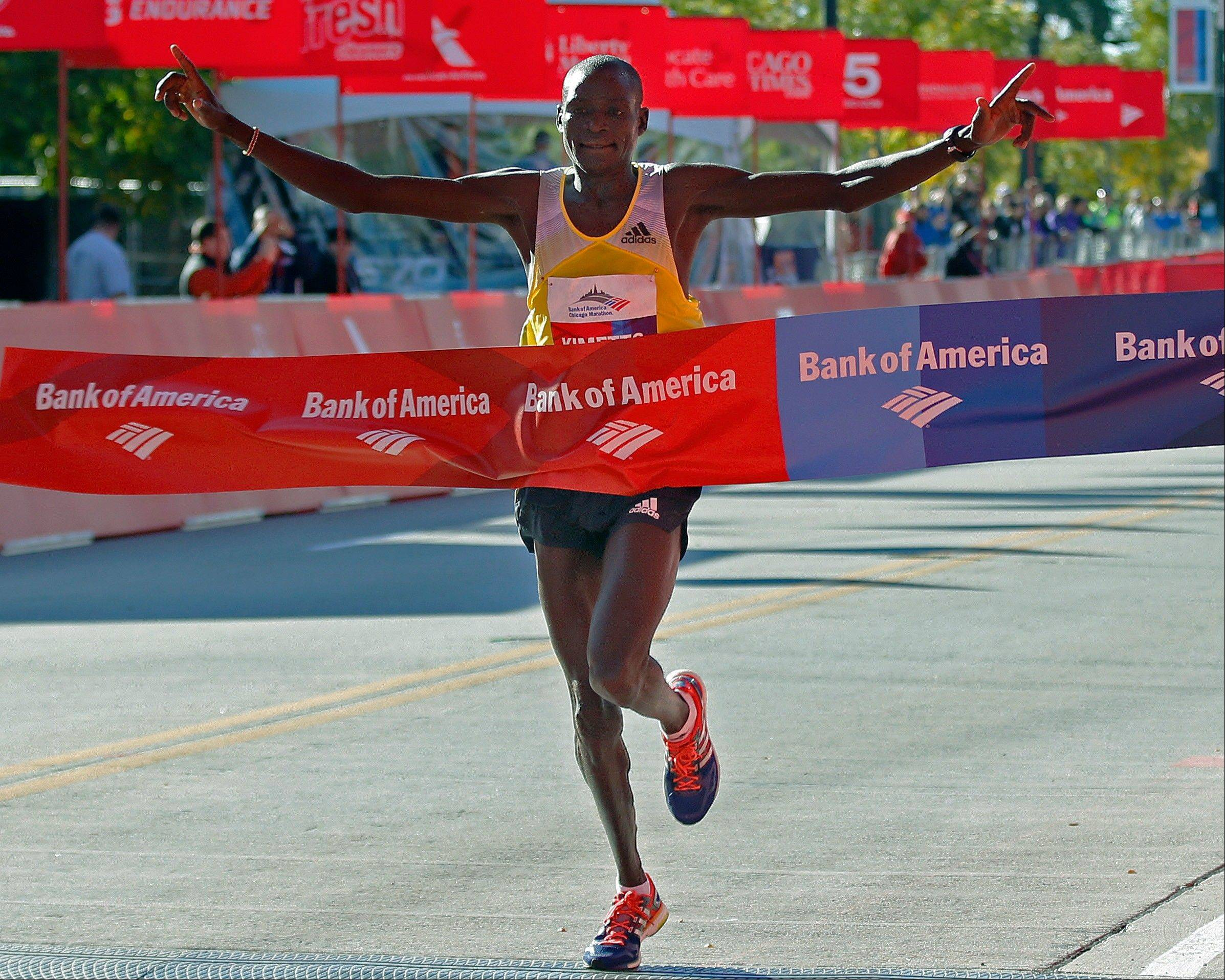 Dennis Kimetto of Kenya crosses the finish line to win the Chicago Marathon on Sunday, Oct. 13, 2013, in Chicago.