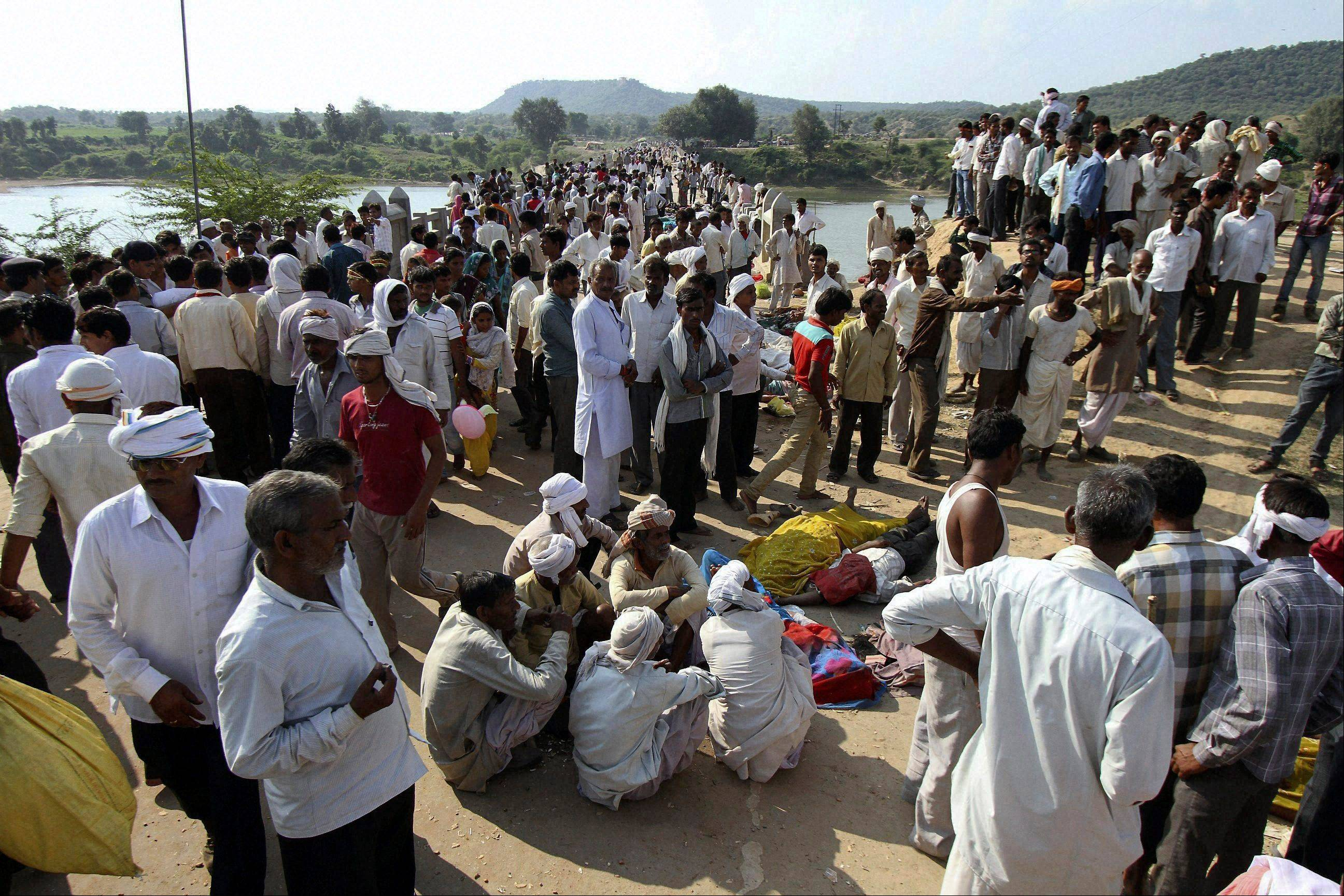 Indian villagers gather after a deadly stampede on a bridge across the Sindh River in Datia district in Madhya Pradesh state.