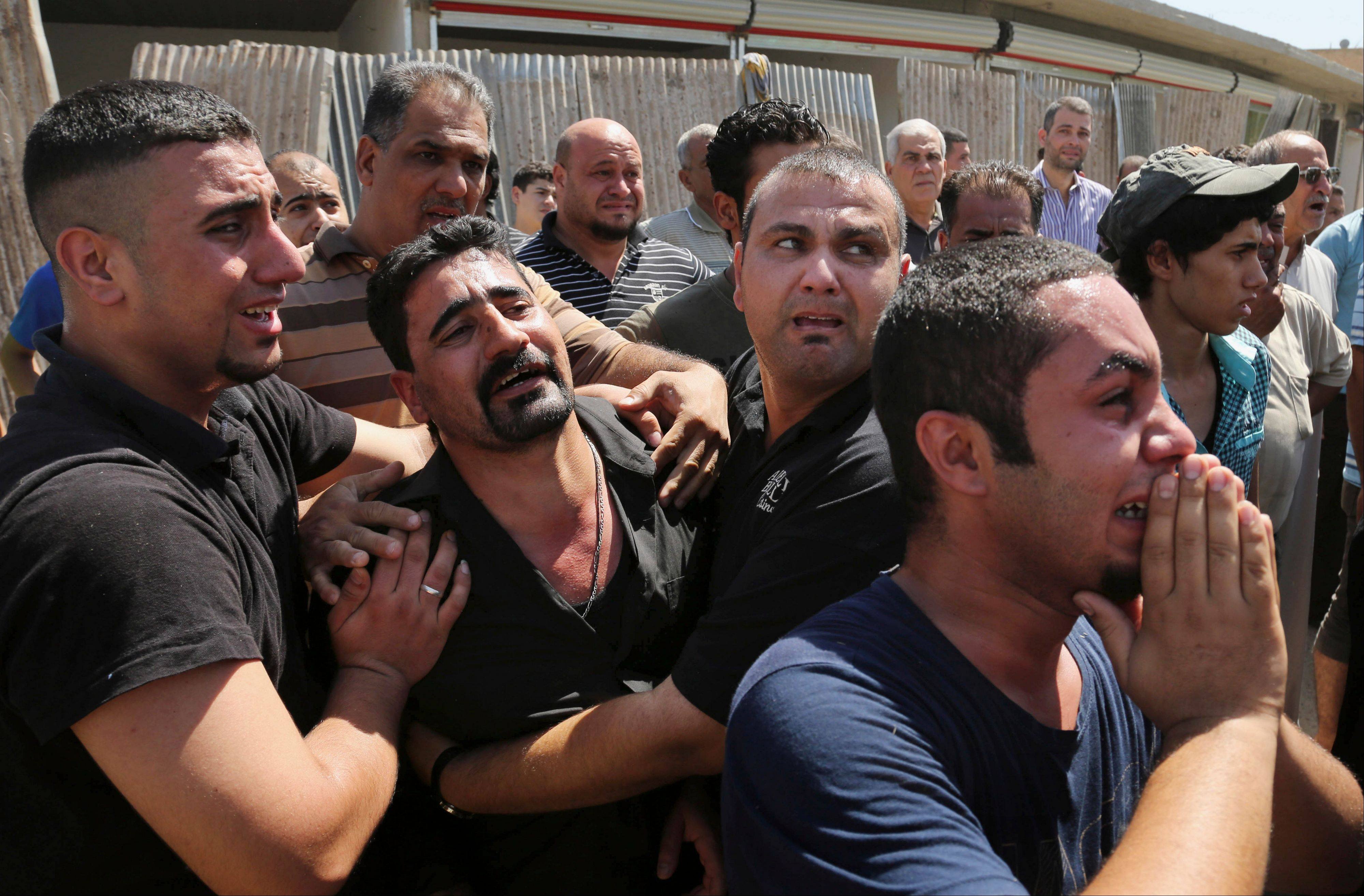 Mourners grieve for a man killed in a double bomb attack on a Shiite mosque in northern Baghdad, Iraq. Al-Qaida sees each attack as a way to maintain an atmosphere of chaos that weakens the Shiite-led government�s authority.