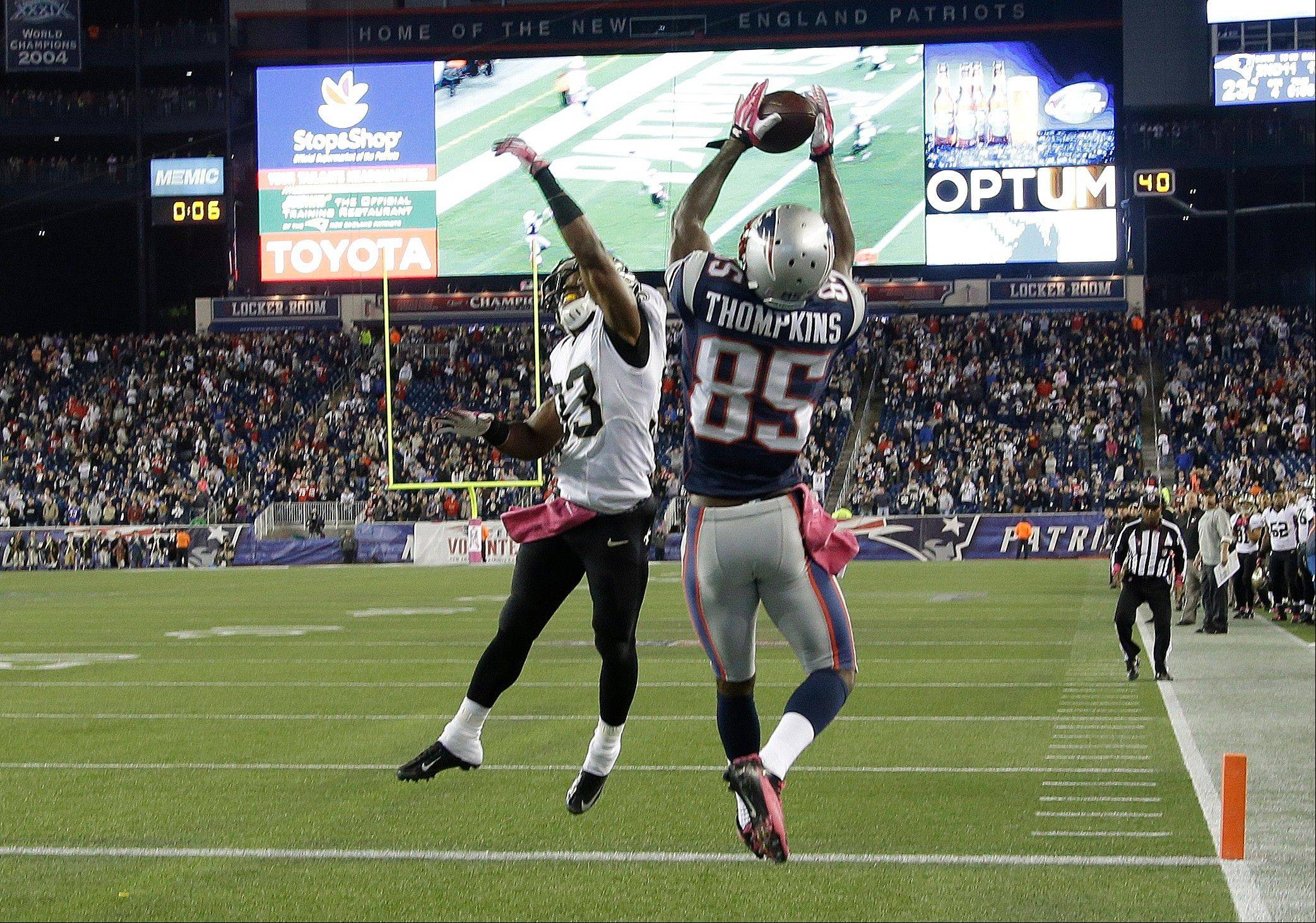 New England Patriots wide receiver Kenbrell Thompkins (85) catches the winning touchdown pass against New Orleans Saints cornerback Jabari Greer (33) in the fourth quarter of an NFL football game Sunday, Oct.13, 2013, in Foxborough, Mass. The Patriots won 30-27.