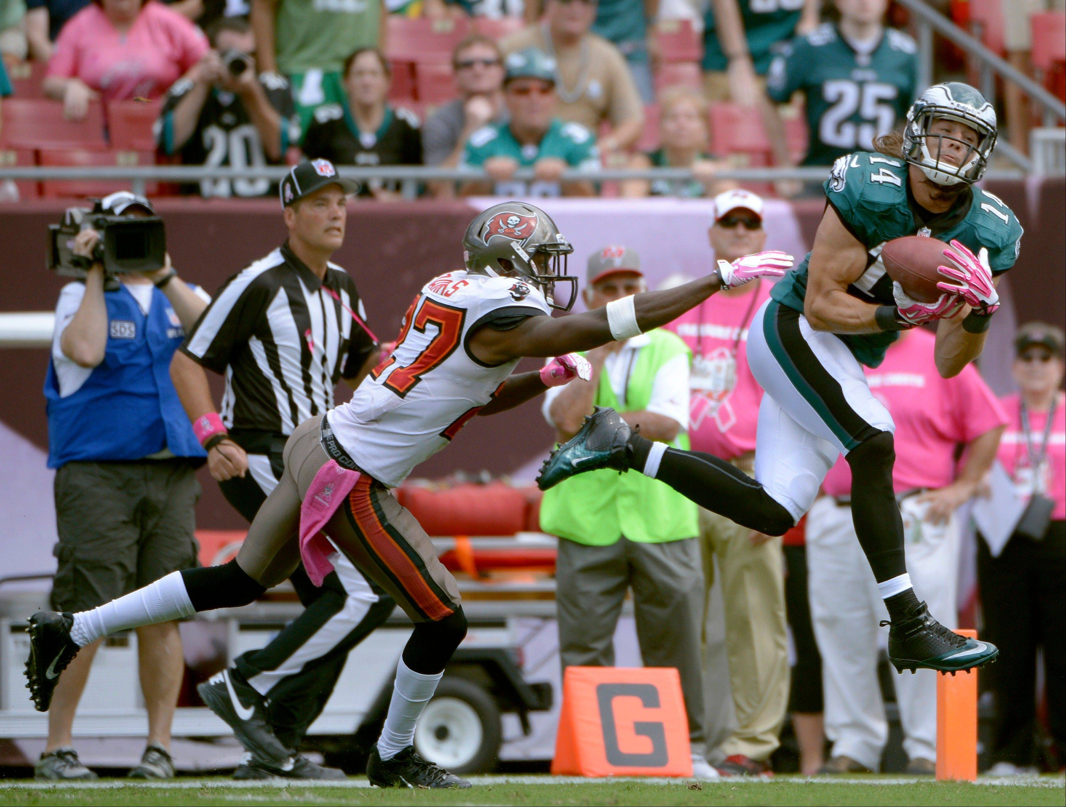 Philadelphia Eagles wide receiver Riley Cooper pulls in a 47-yard touchdown reception in front of Tampa Bay Buccaneers cornerback Johnthan Banks during the third quarter Sunday in Tampa, Fla.