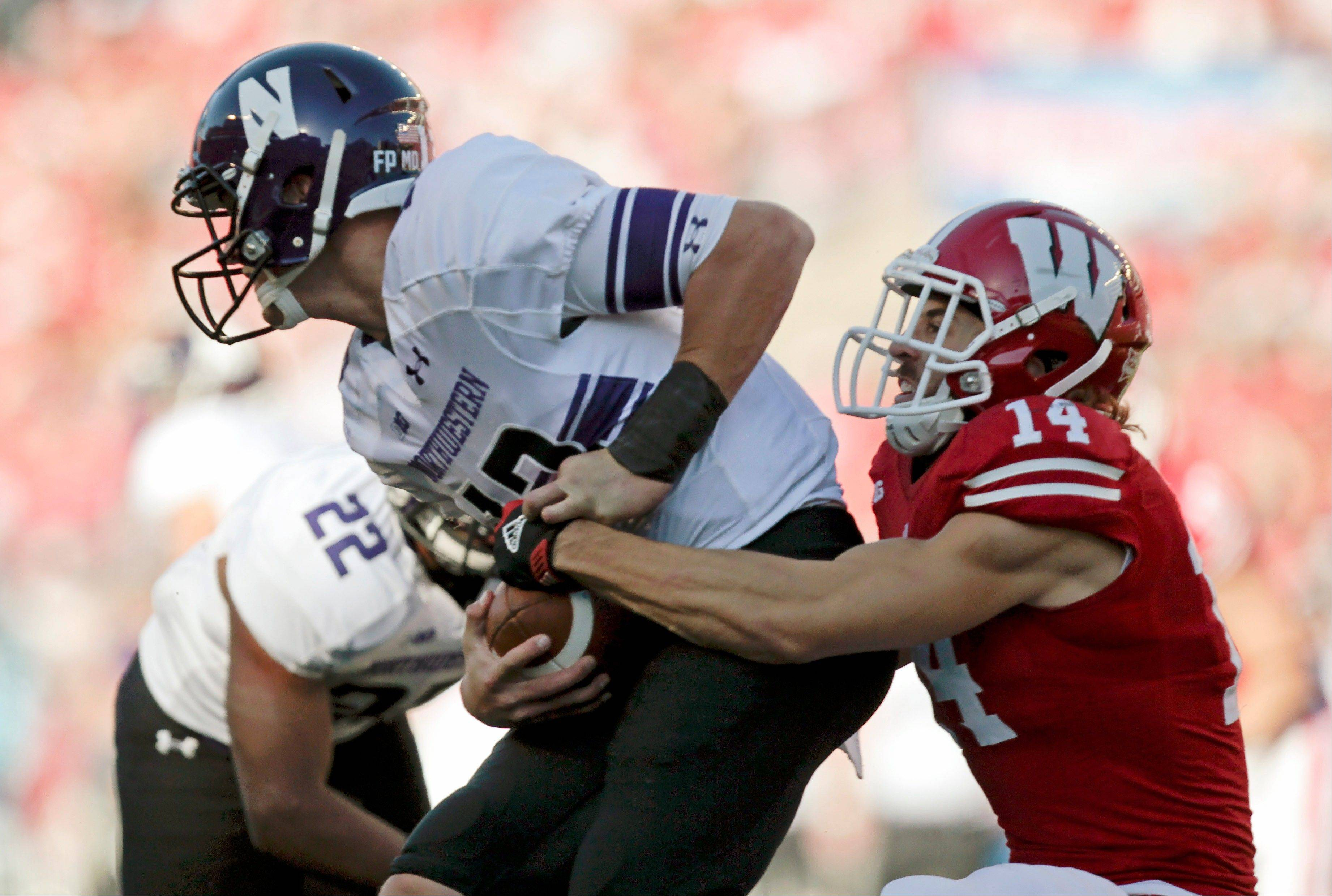 Wisconsin safety Nate Hammon sacks Northwestern quarterback Trevor Siemian on Saturday in Madison, Wis. The Badgers won 35-6.