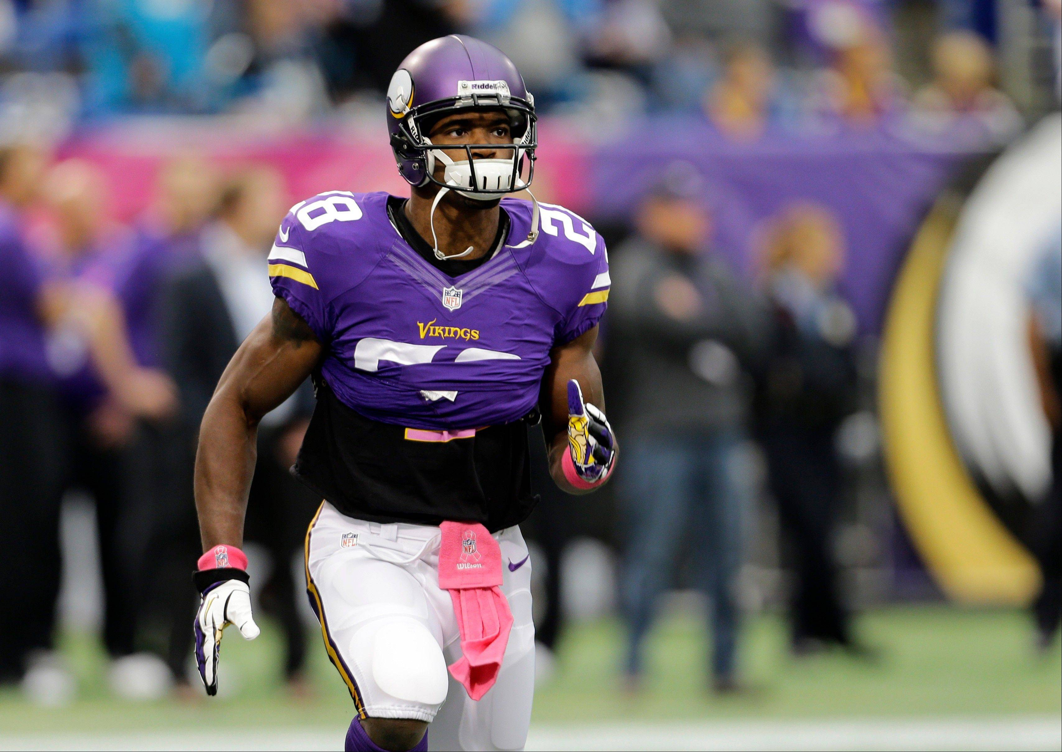 Peterson active for game after son's death