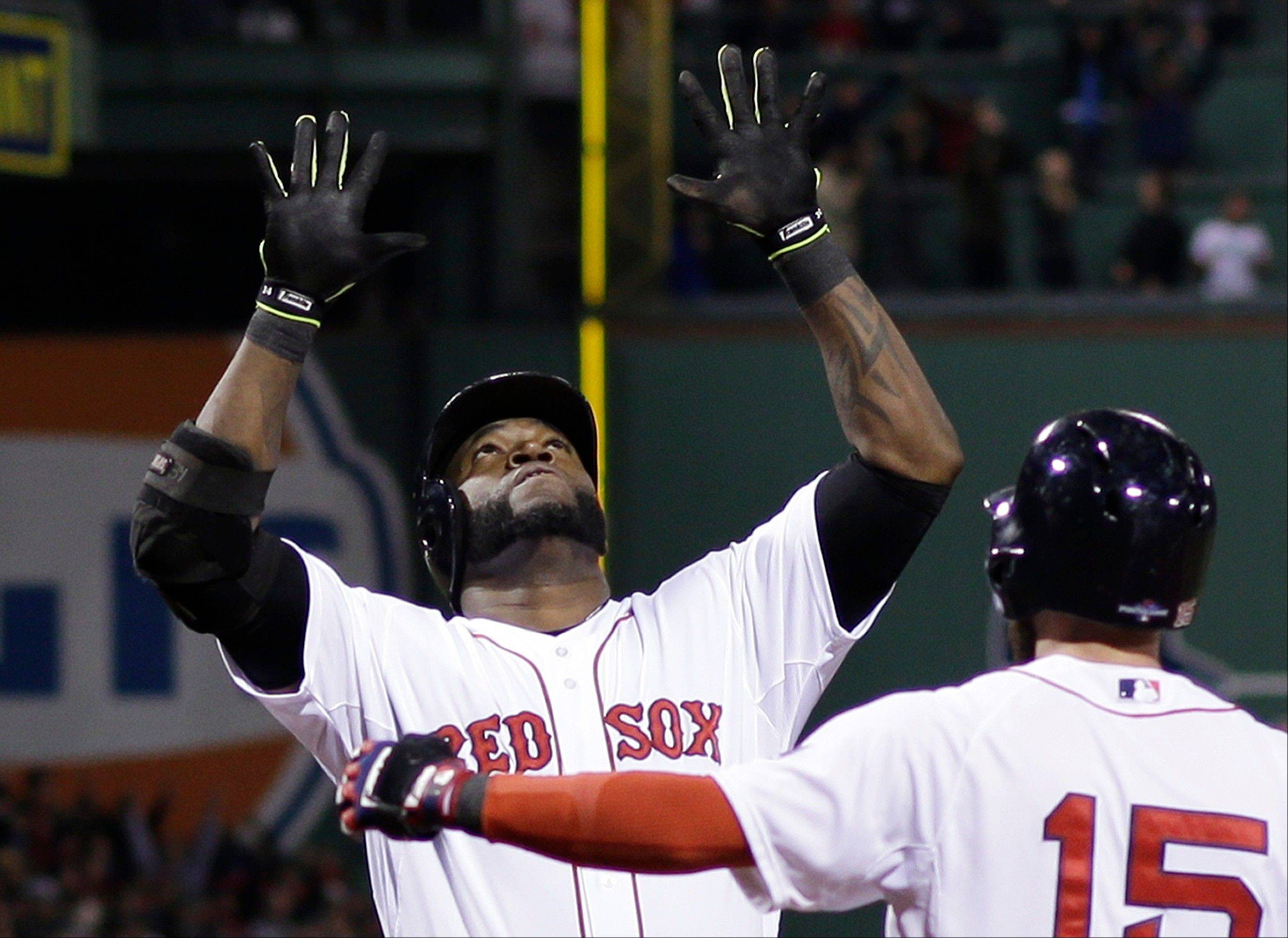 Boston Red Sox's David Ortiz celebrates with Dustin Pedroia after hitting a grand slam home run in the eighth inning during Game 2 of the American League baseball championship series against the Detroit Tigers Sunday, Oct. 13, 2013, in Boston.