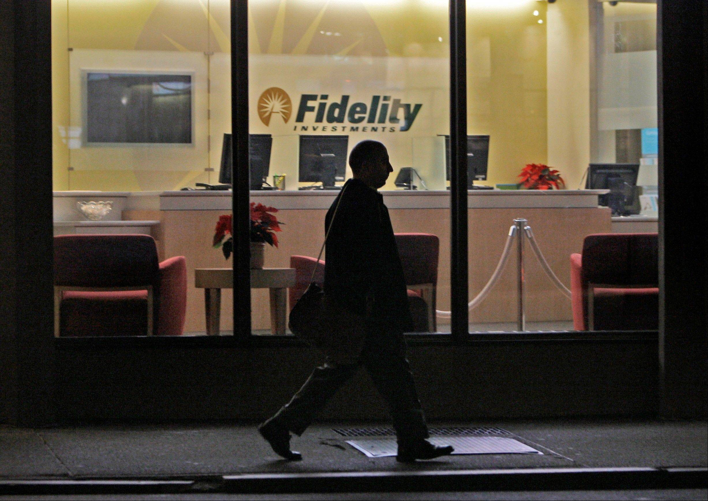 A man walks past a Fidelity Investments office in the Financial District of downtown Boston. Global investors still see it as the world's best place to park their money. Even the threat of an unprecedented government default doesn't seem to have dulled the allure of Teflon America.