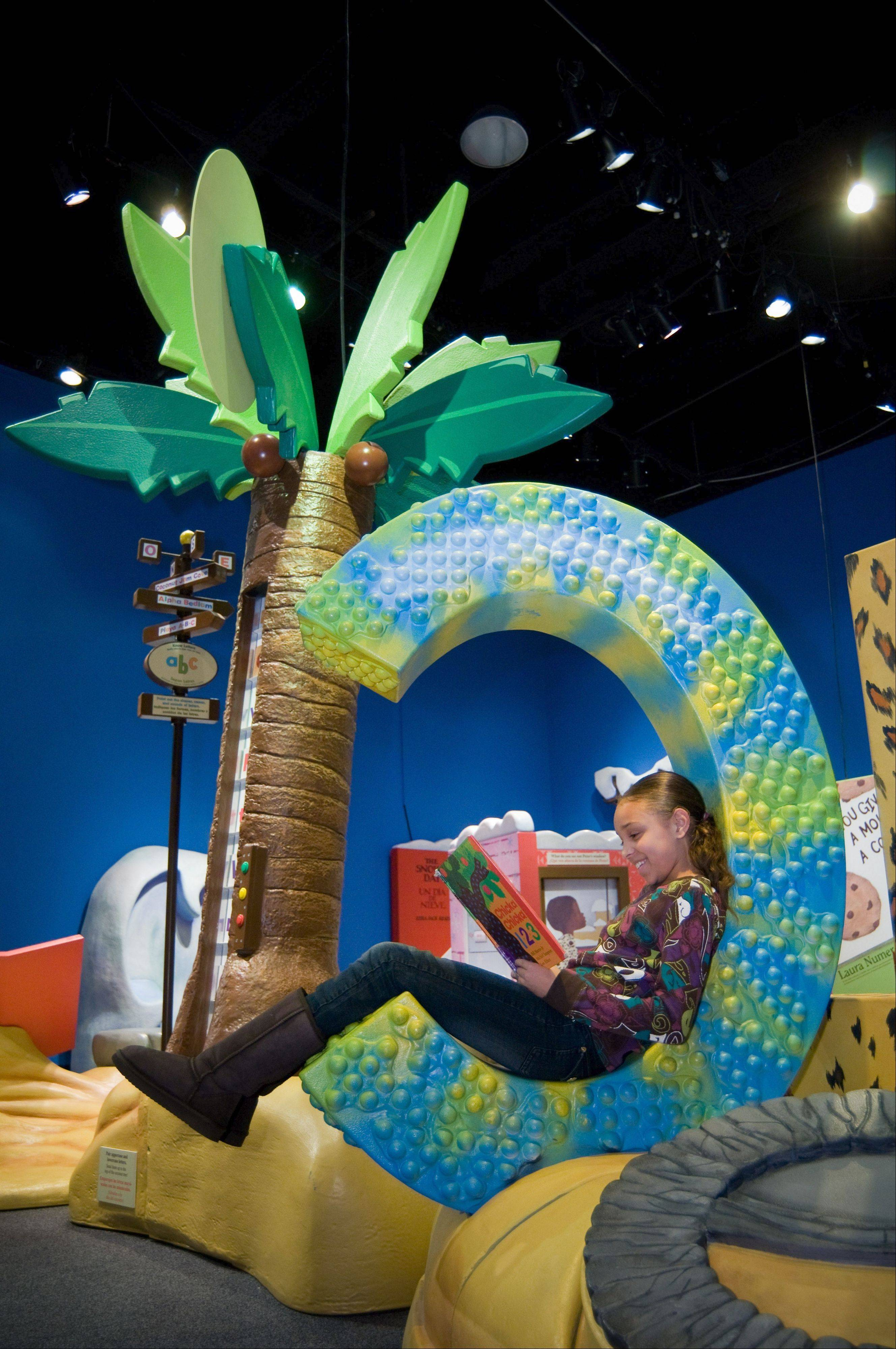"""Storyland: A Trip Through Childhood Favorites"" at Kohl Children's Museum pays tribute to a number of classics like the popular ""Chicka Chicka Boom Boom."""