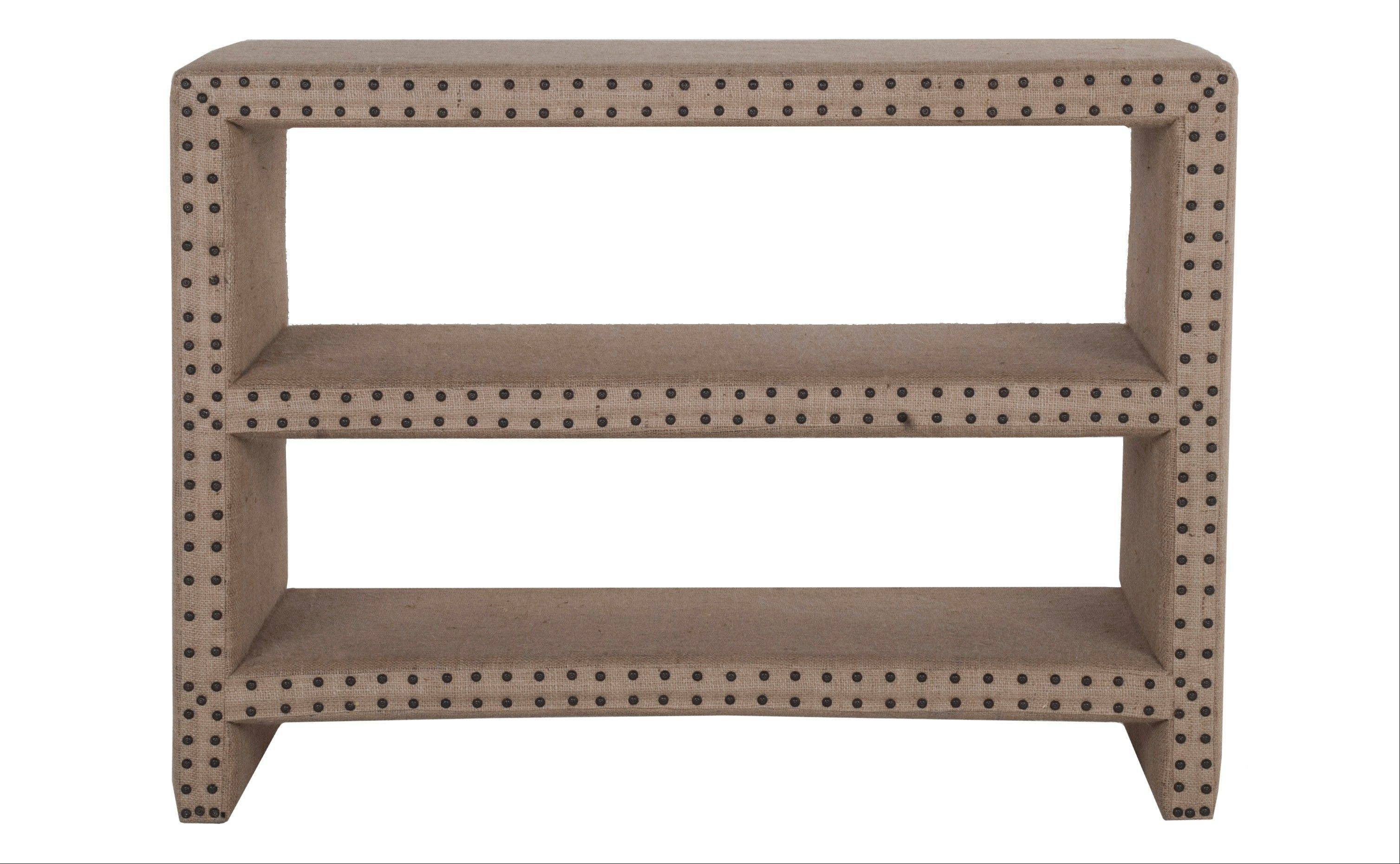A Bretton burlap shelf that combines modern lines and a rustic texture is accented with nailhead trim.