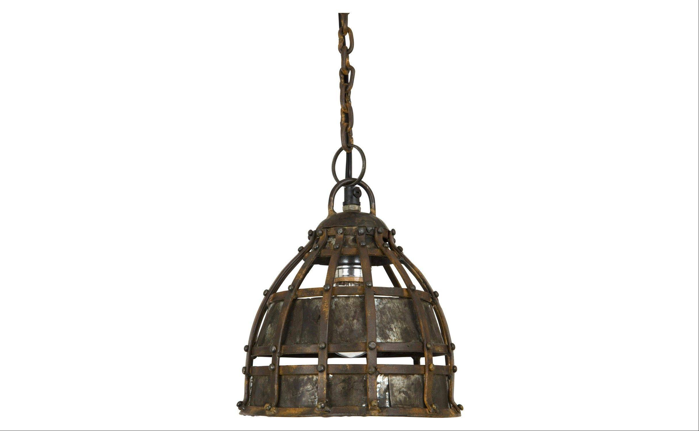 The Ludlam pendant lamp, with its cage of riveted metal that gives the lighting fixture an industrial look.