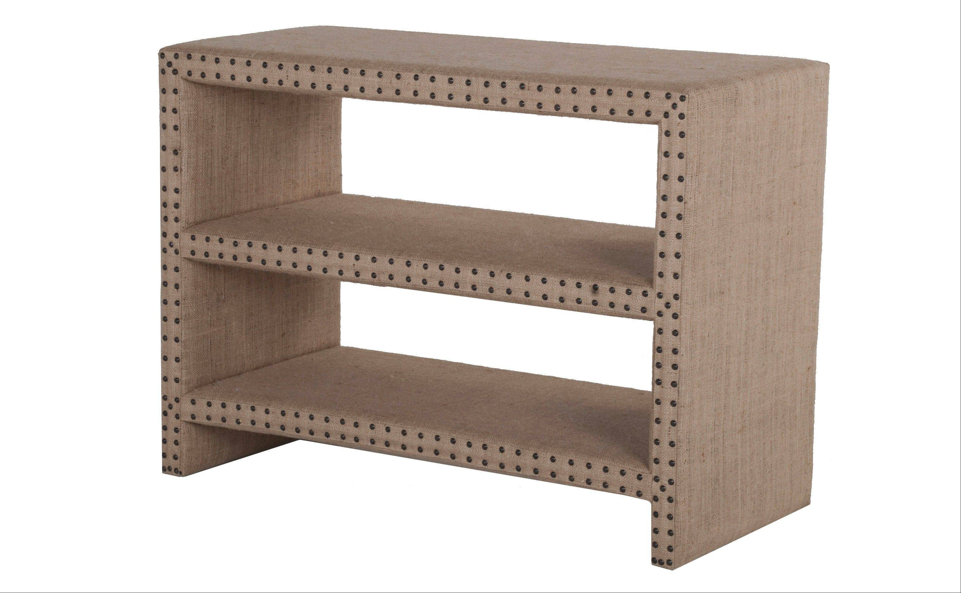 A Bretton burlap shelf that combines modern lines and a rustic texture, accented with nailhead trim.